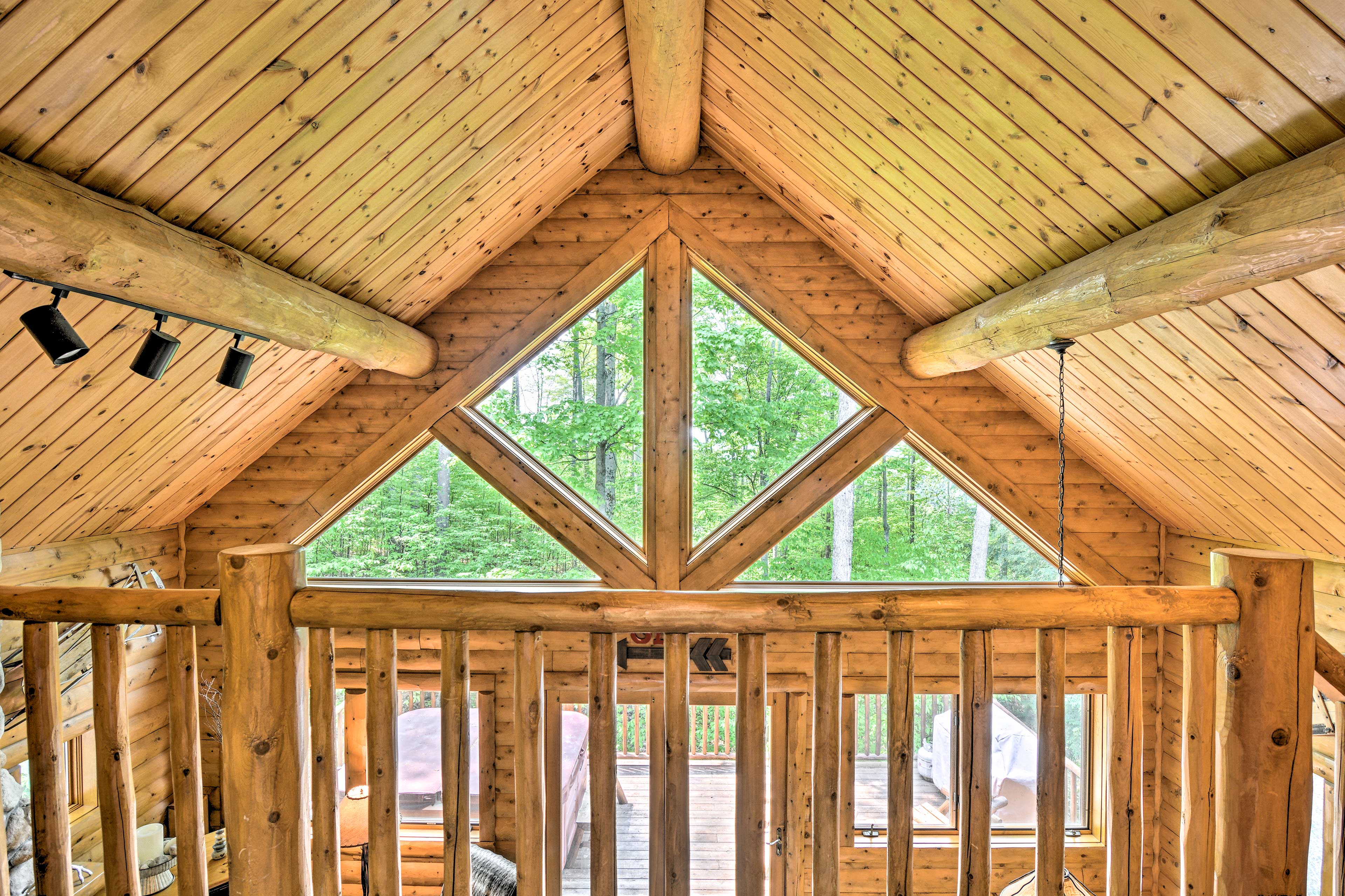 Upstairs, a loft overlook provides stunning views of the wilderness!