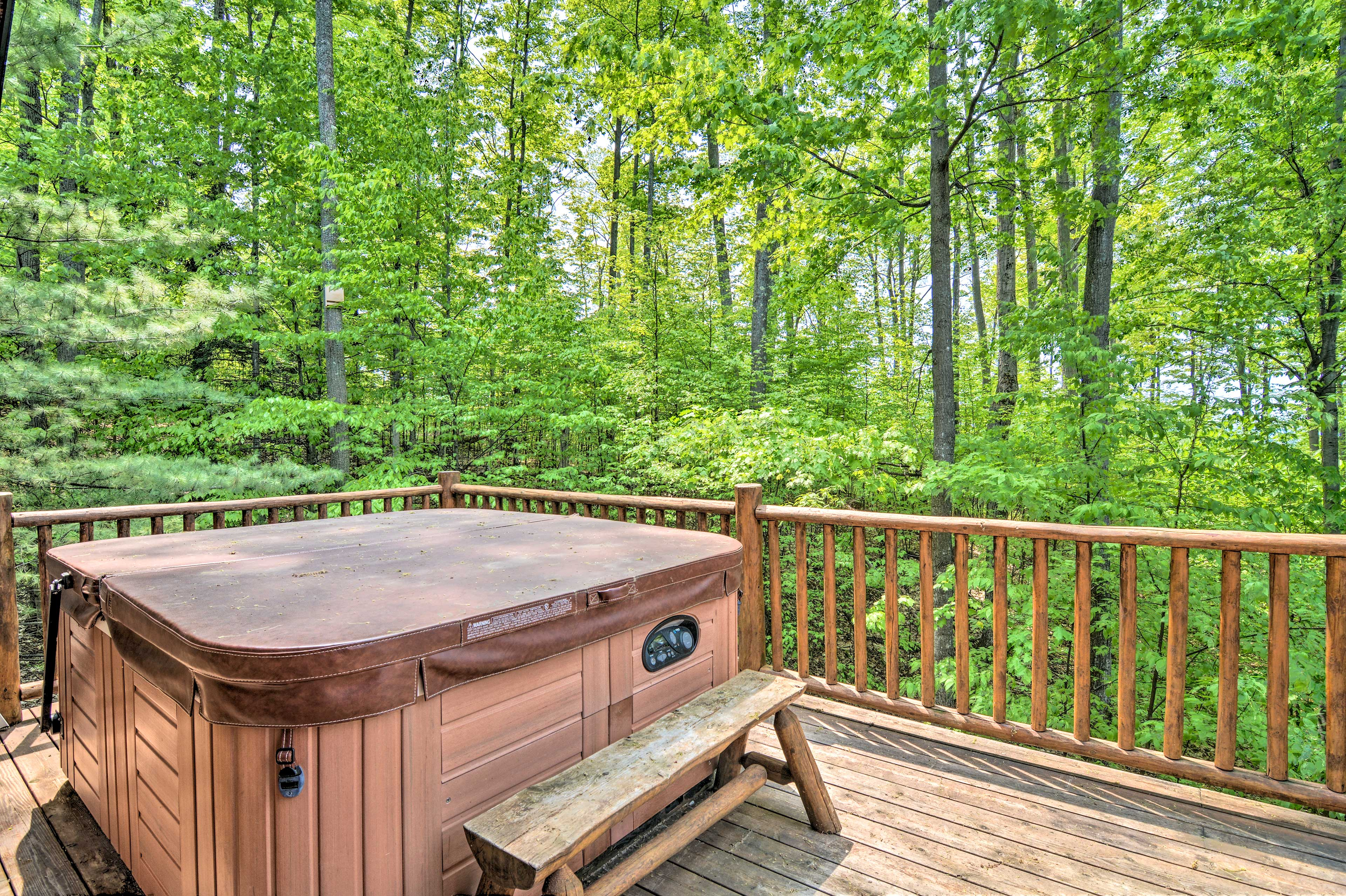 Soak in the forest views from the private hot tub on the back deck!