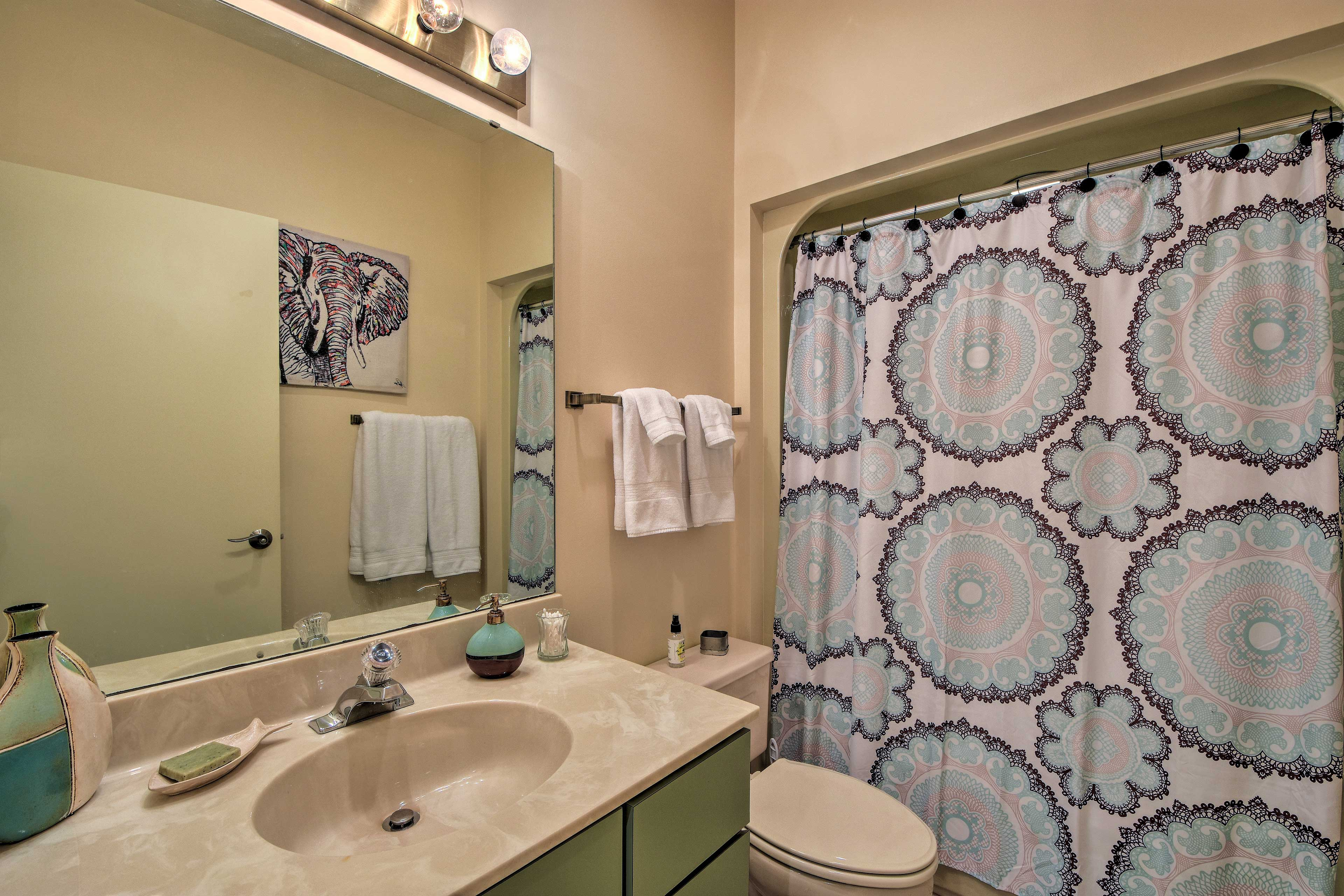 A shower/tub combo furnishes this full bathroom.