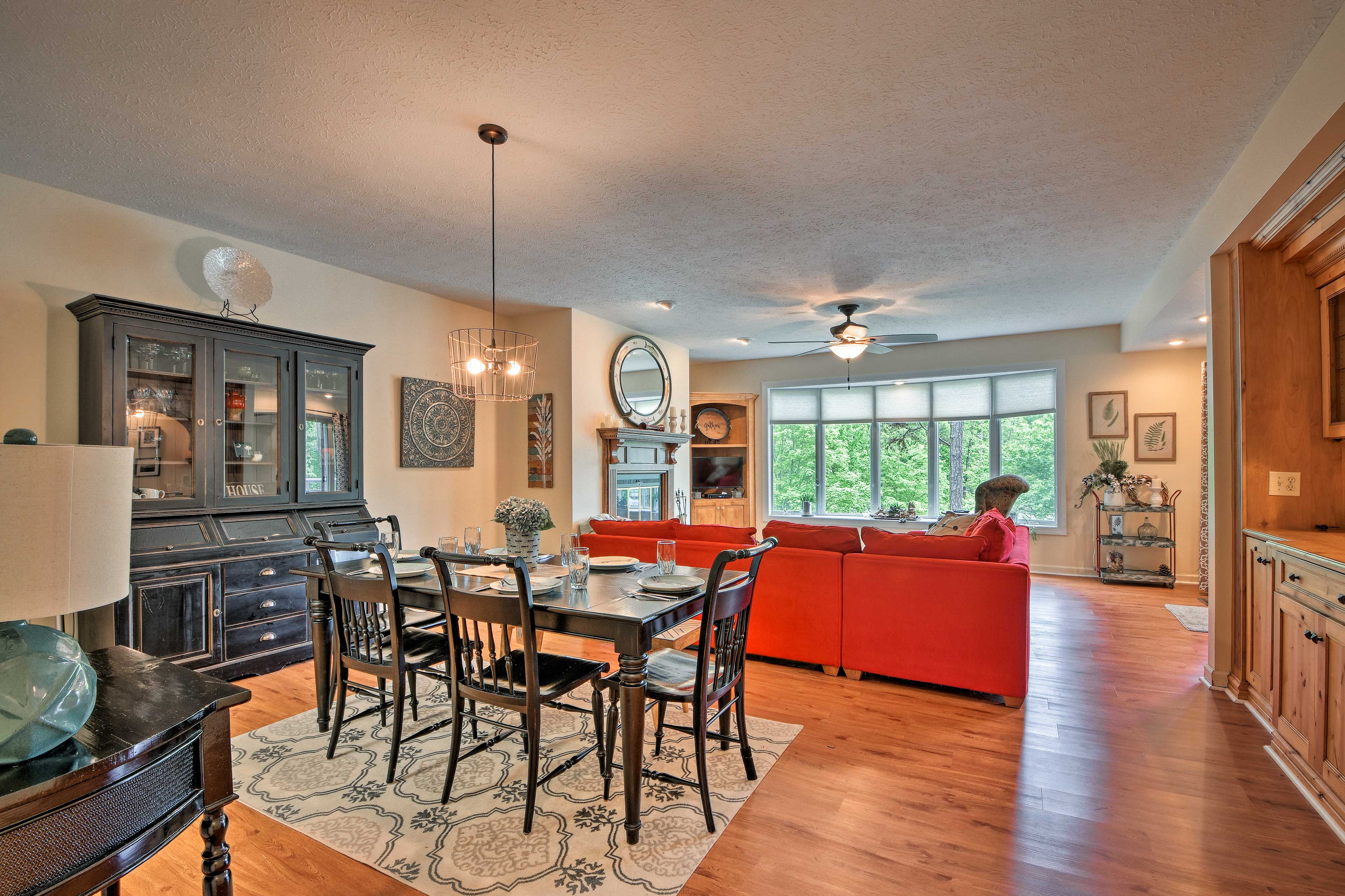 Gather around the formal dining table to enjoy a home-cooked meal.