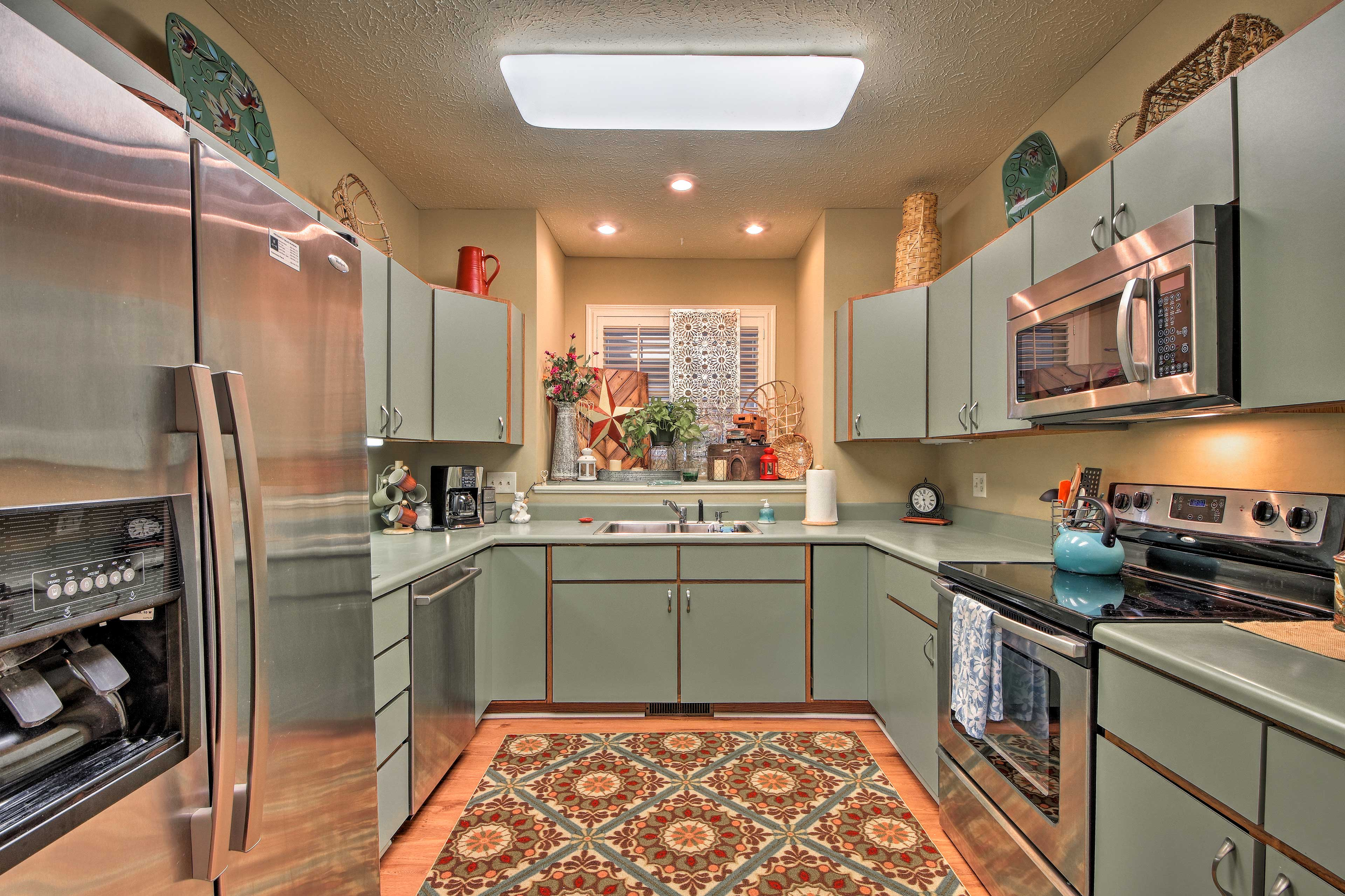 The kitchen is furnished with stainless steel appliances!