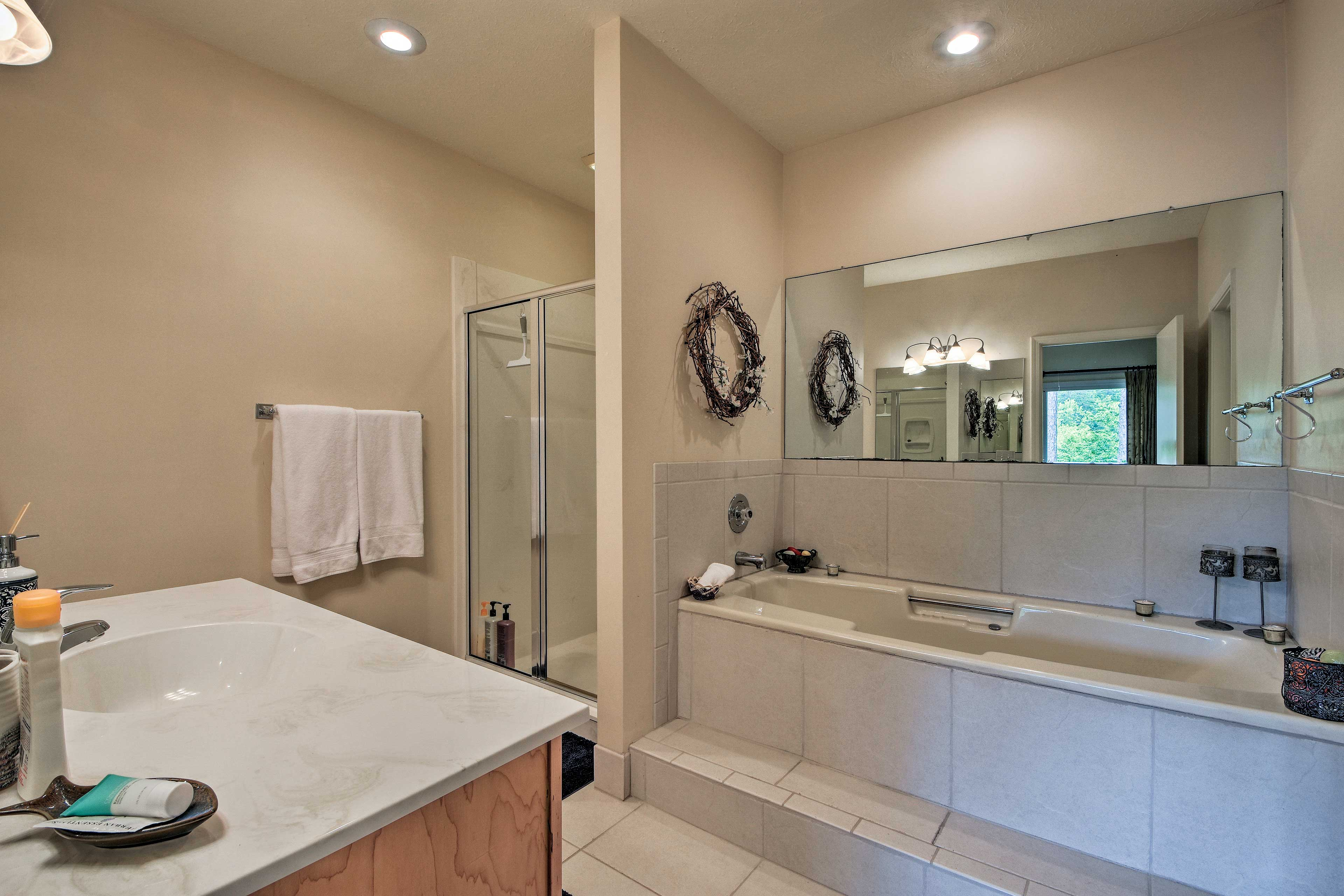 The en-suite bathroom features a soaking tub and a separate shower.