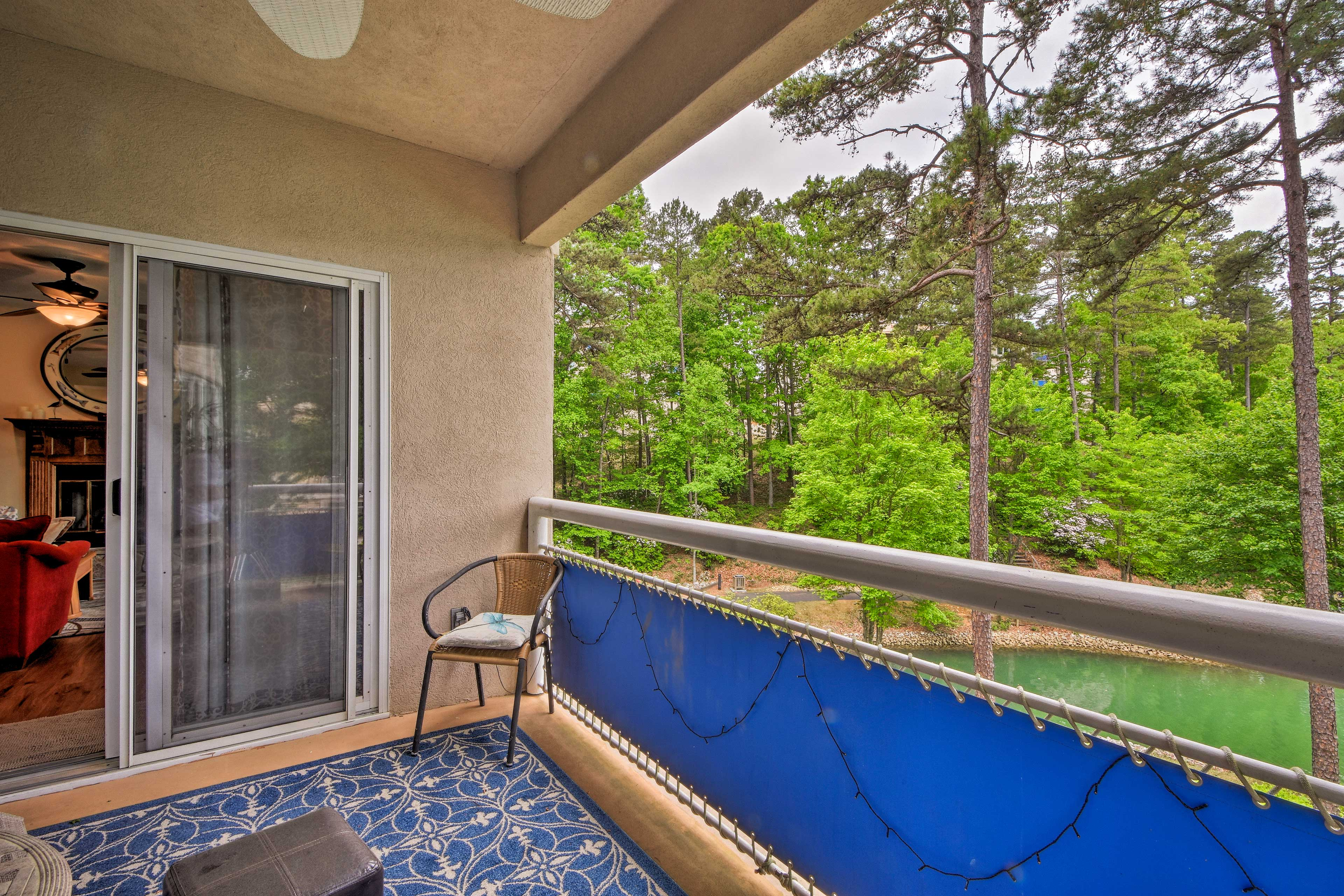 Relax outside on the balcony with views of the water.