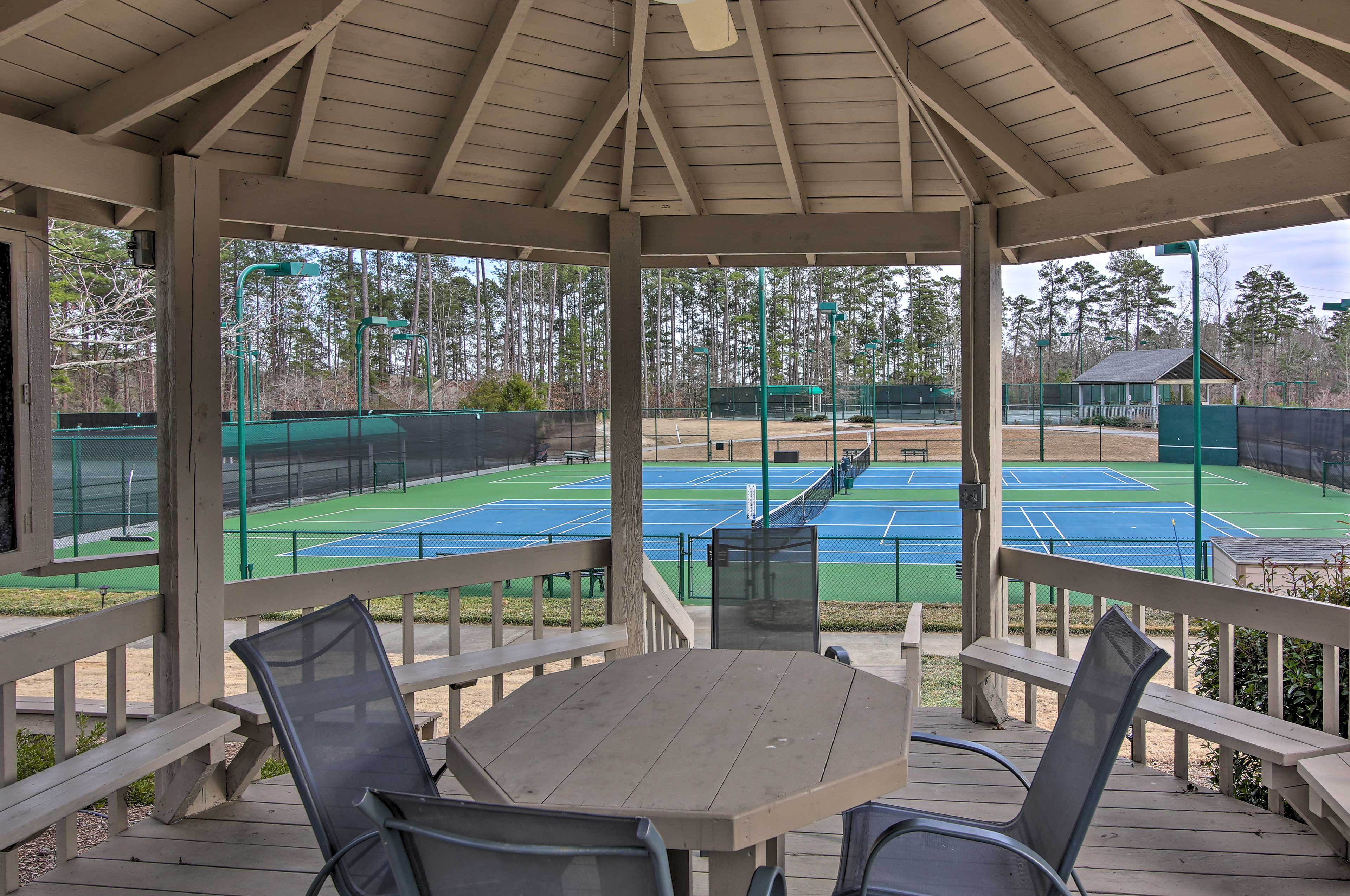 Stop your tennis match for a quick snack and a drink at the gazebo table.