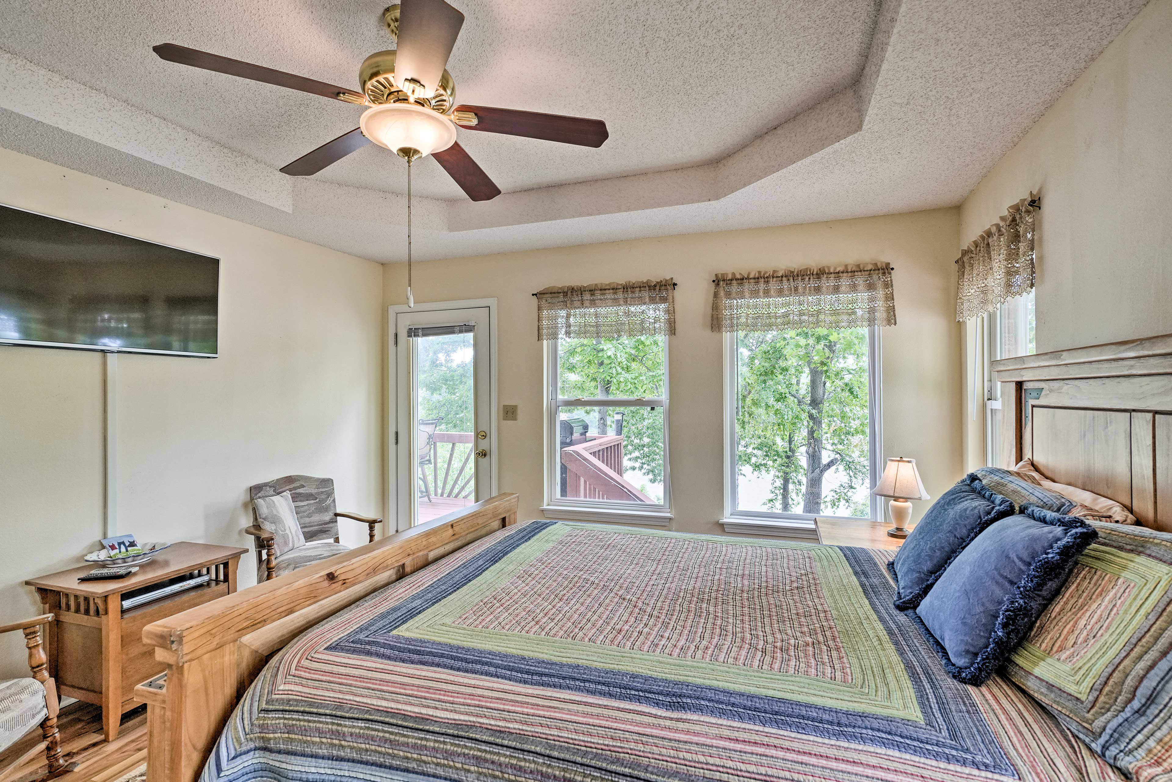 The master bedroom also features private deck access and a flat-screen TV.