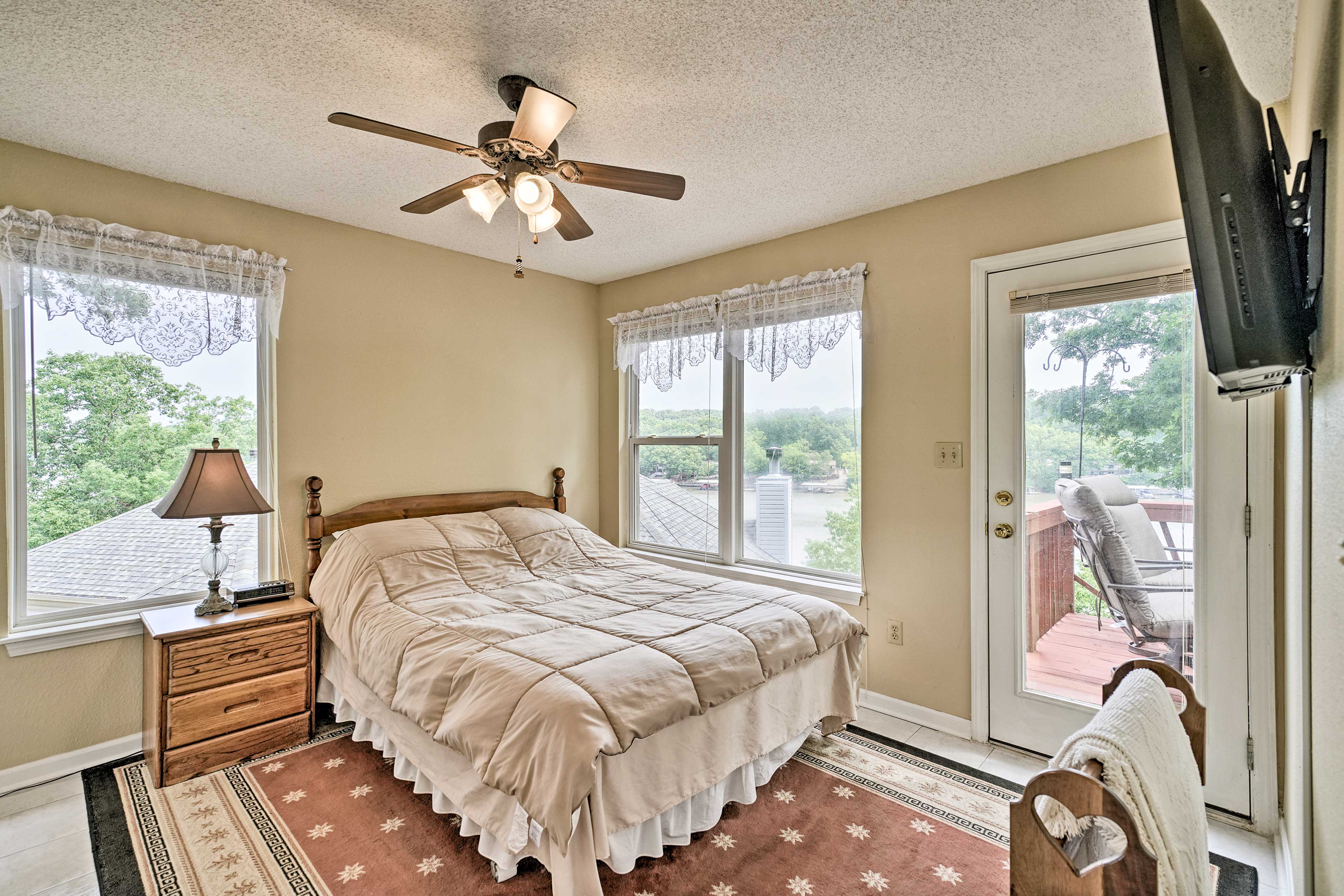 Sleepy? Retire to this bedroom featuring private deck access.