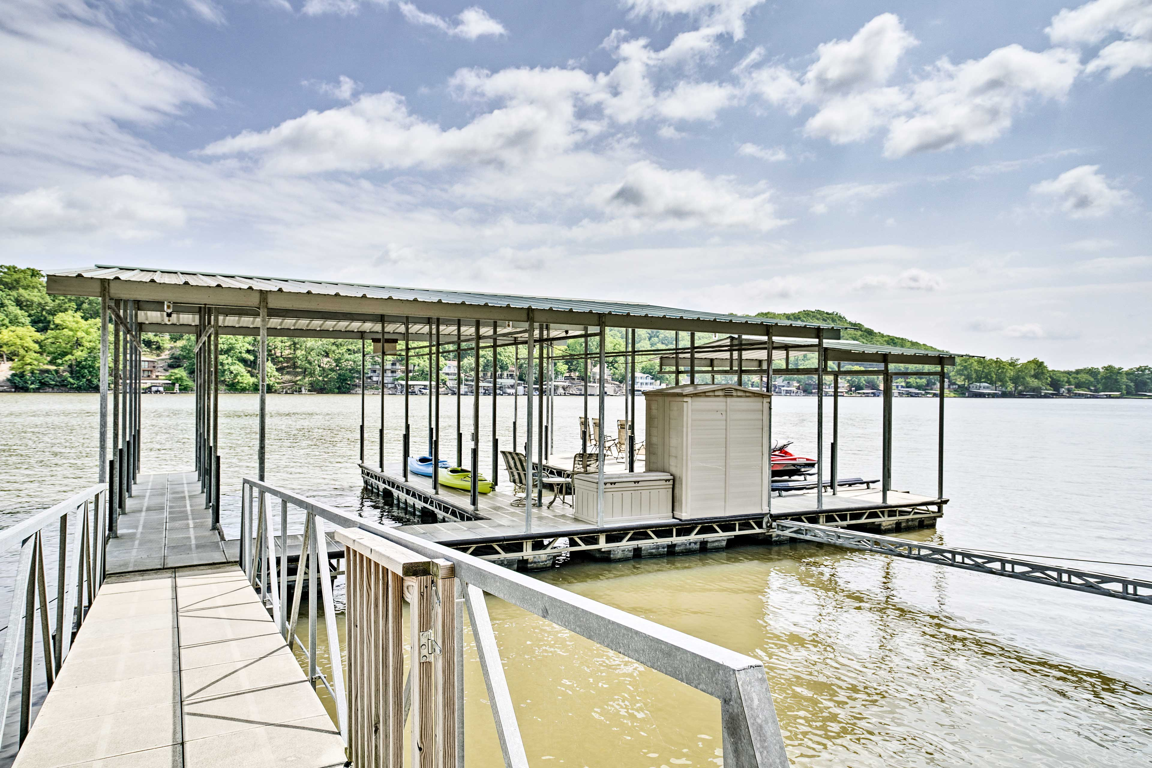 The vacation rental boasts a private dock with a boat slip and a dual PWC lift!