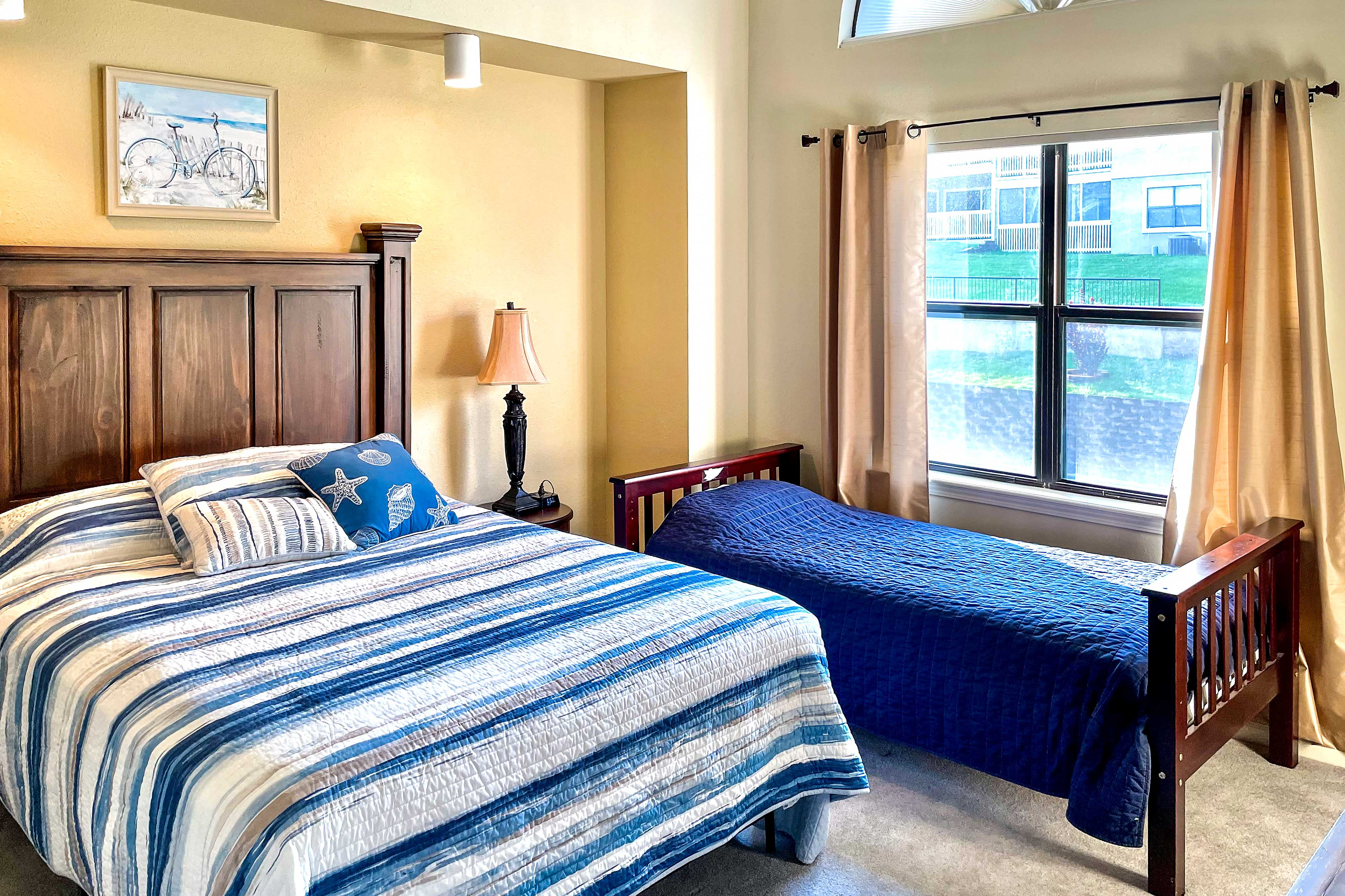 The second bedroom boasts a queen and a twin bed.