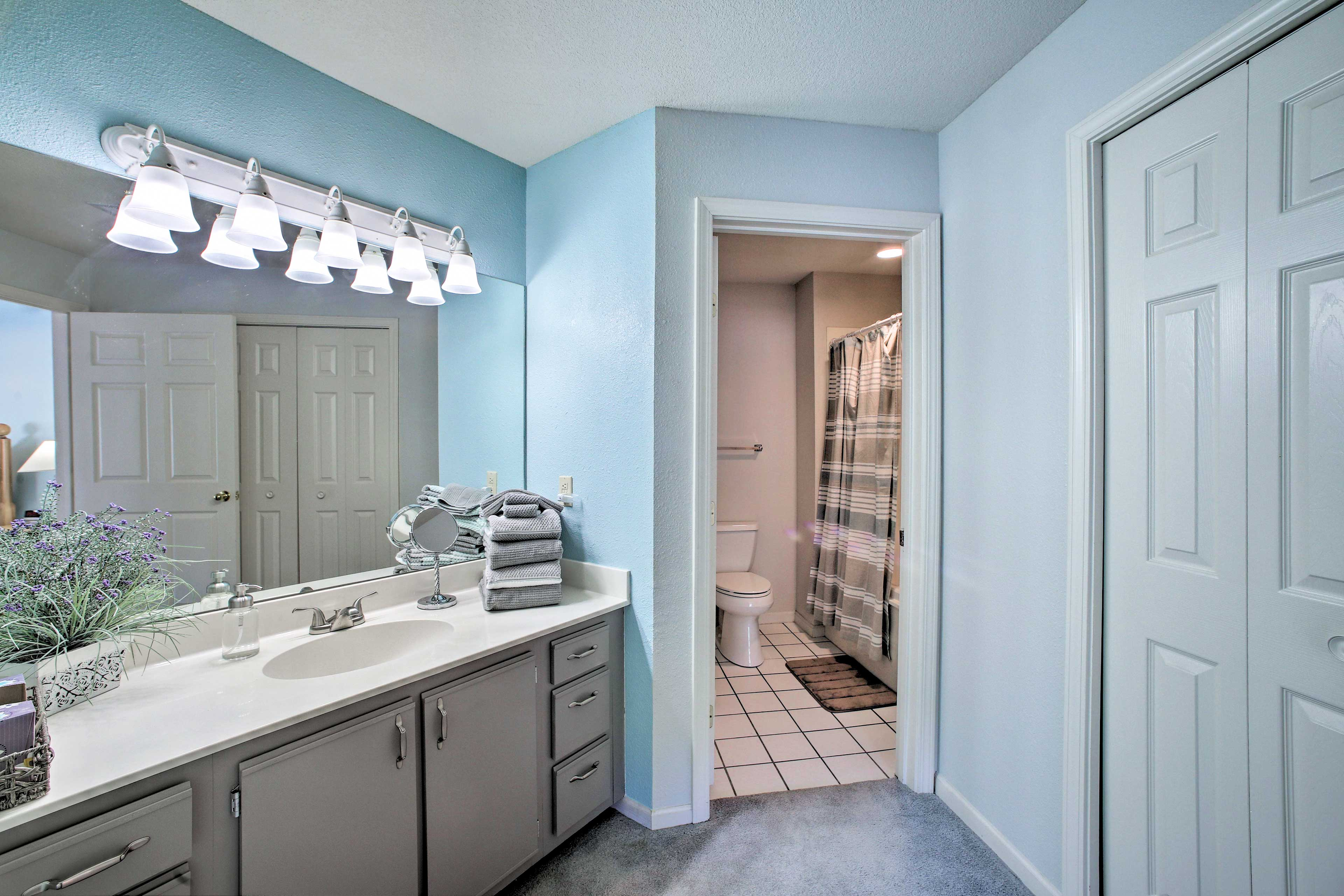 Freshen up in this full bathroom.