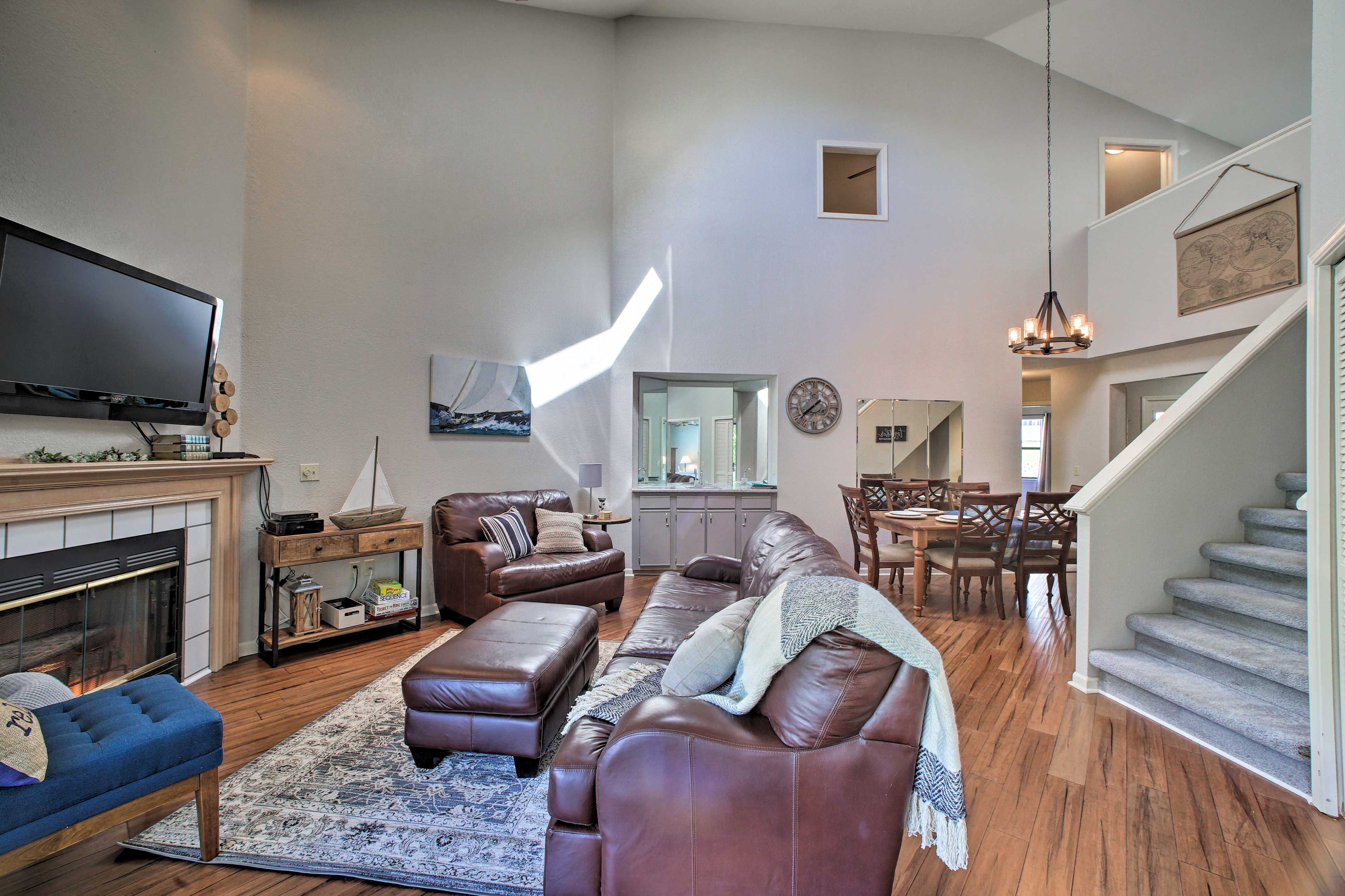 Hardwood floors and plush furnishings elevate this home.