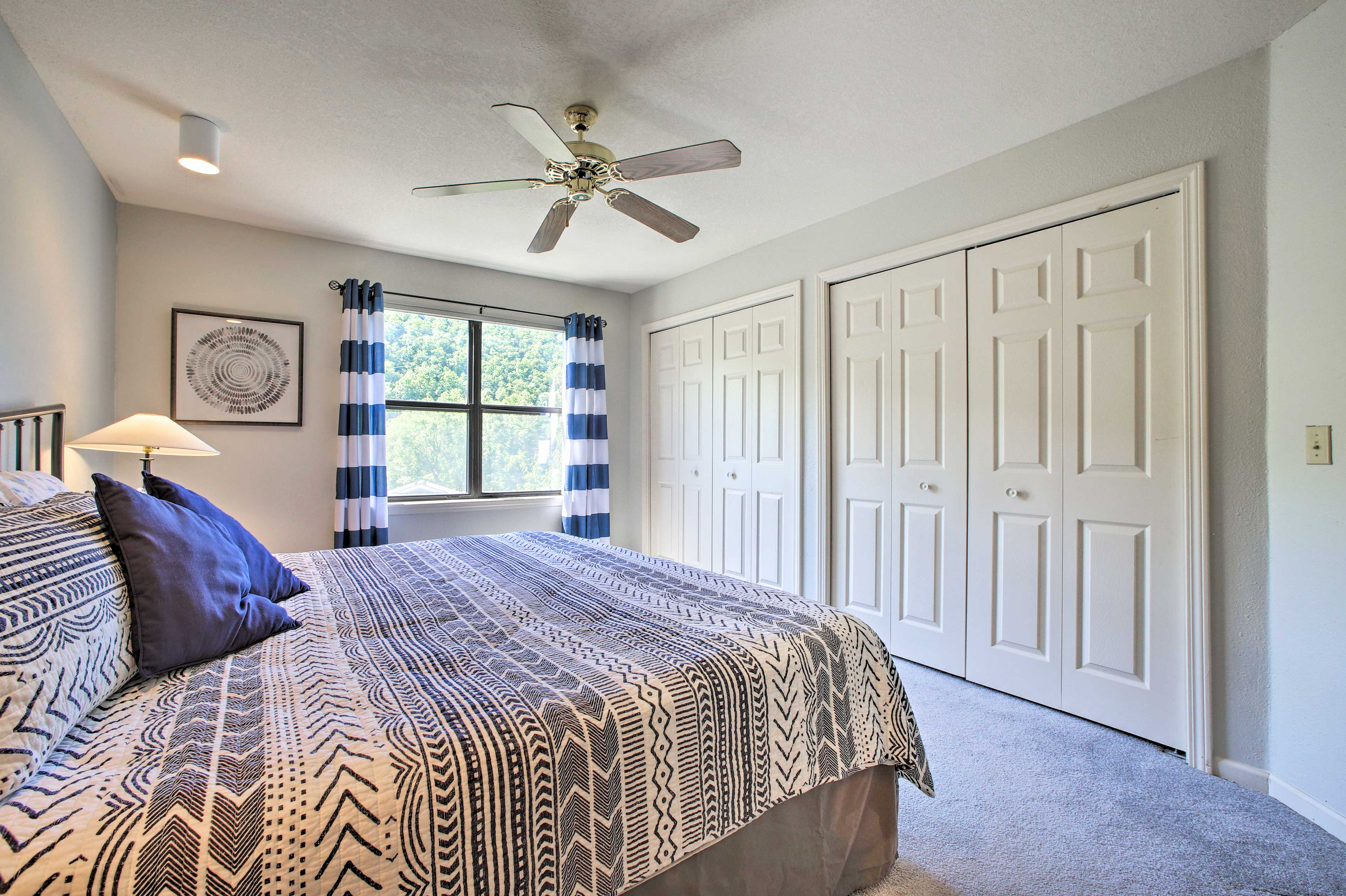 Drift off to dreamland in this spacious bedroom with a queen bed.