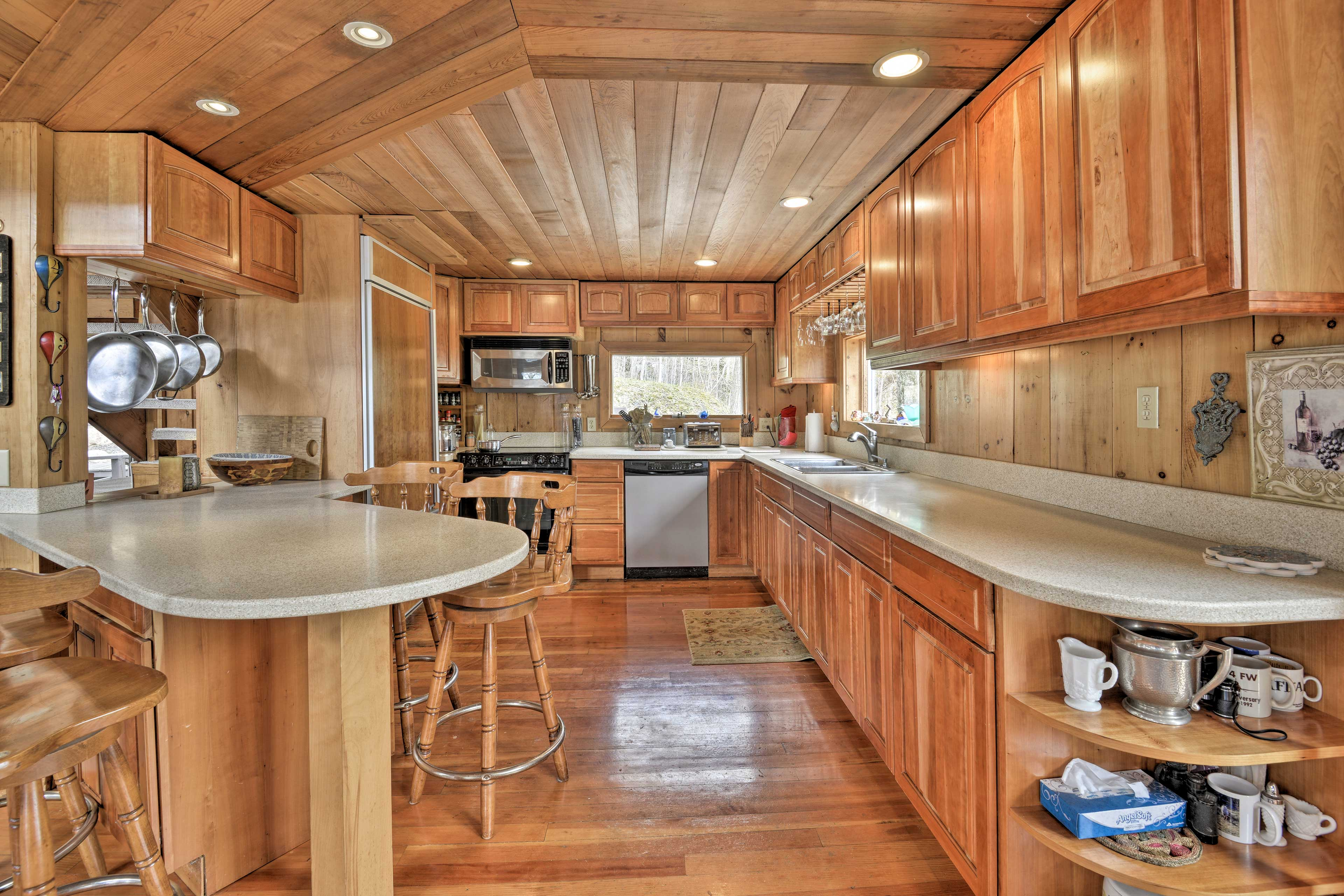 The fully equipped kitchen features a 4-person bar and ample counter space.