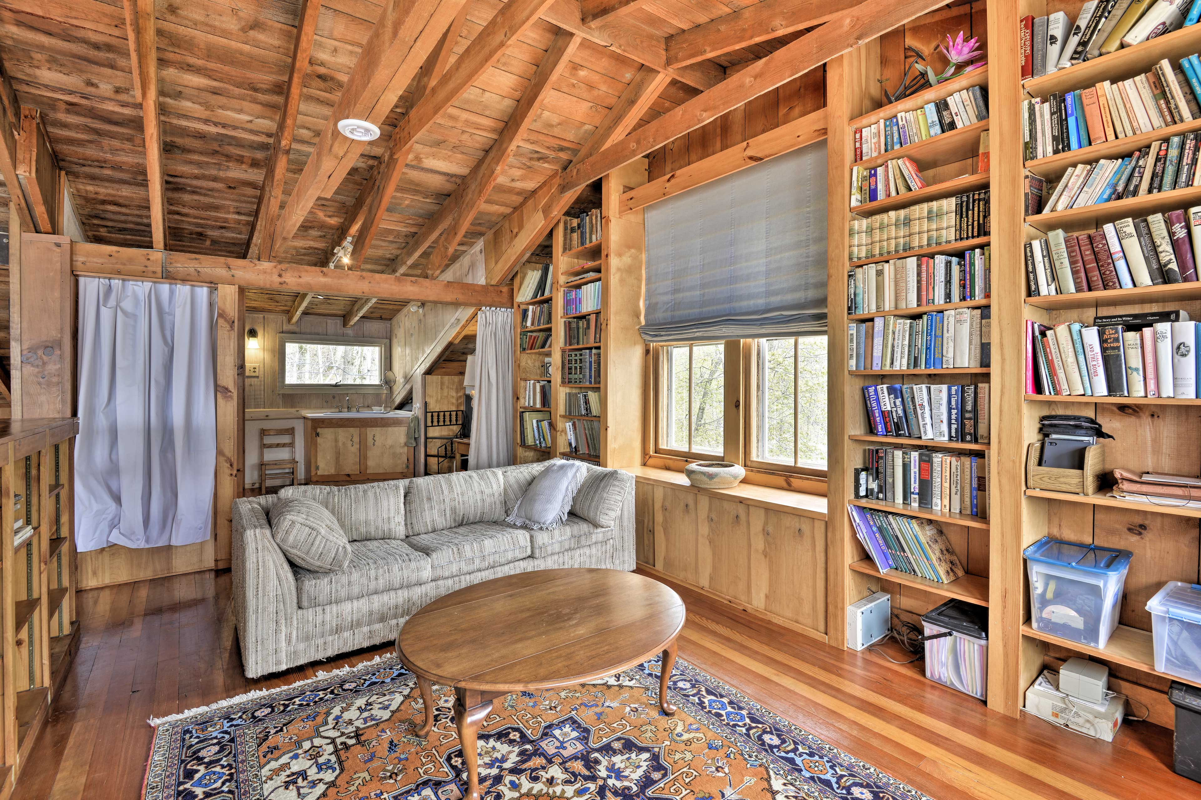 Up in the loft, you'll find a second bathroom and cozy reading nook.