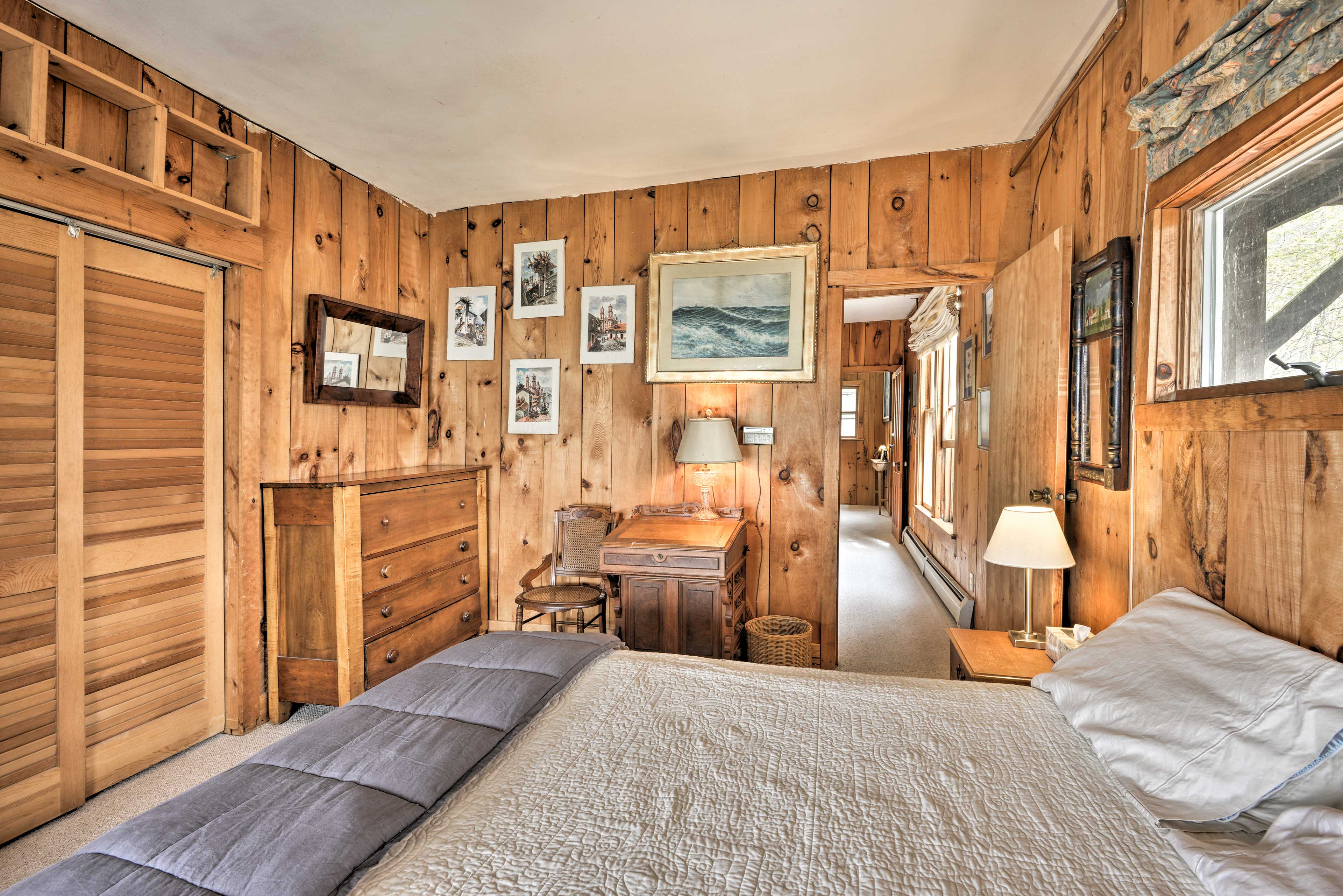 This bedroom also features ample storage space and direct deck access.
