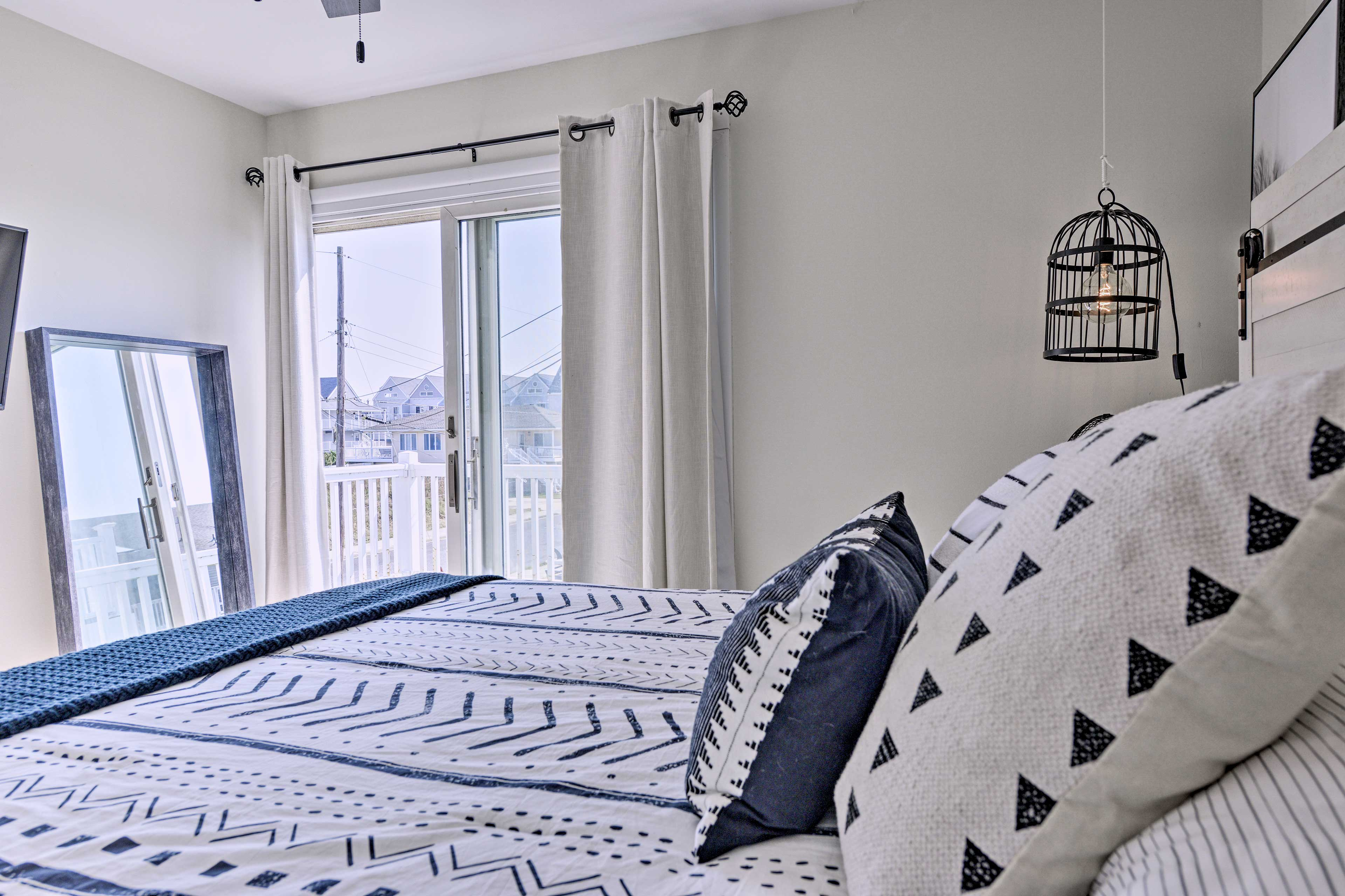 The room includes access to a private deck.