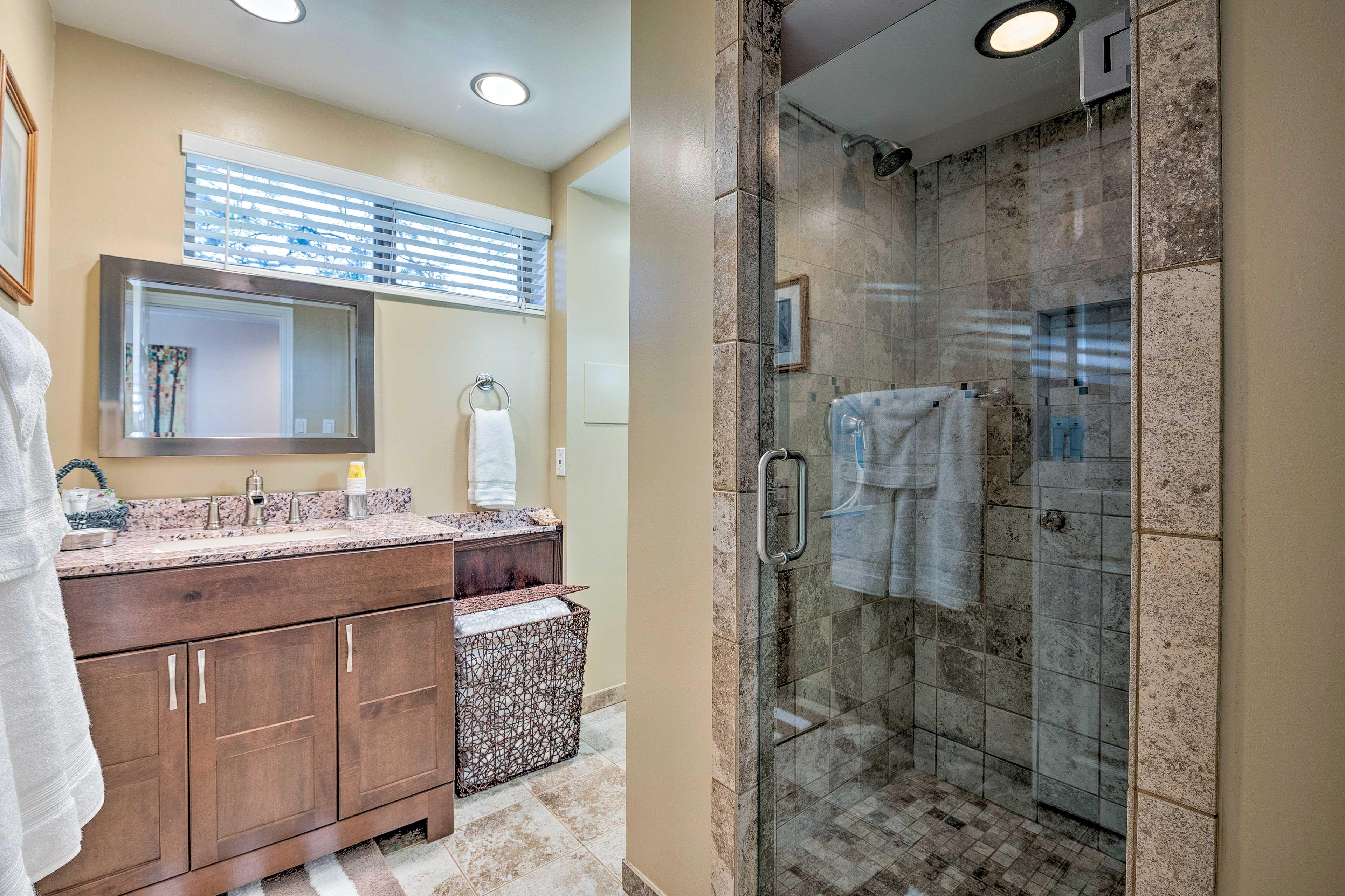 The full bathroom boasts a beautiful, tiled walk-in shower.