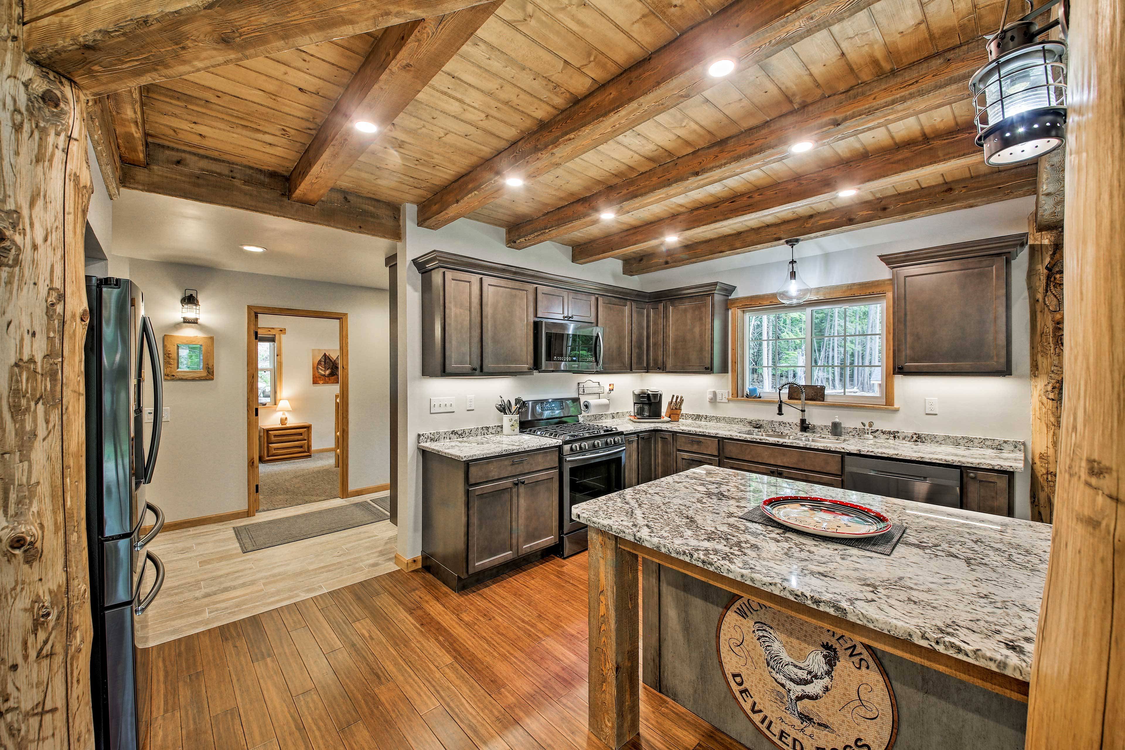 Upgraded stainless steel appliances also elevate the space.