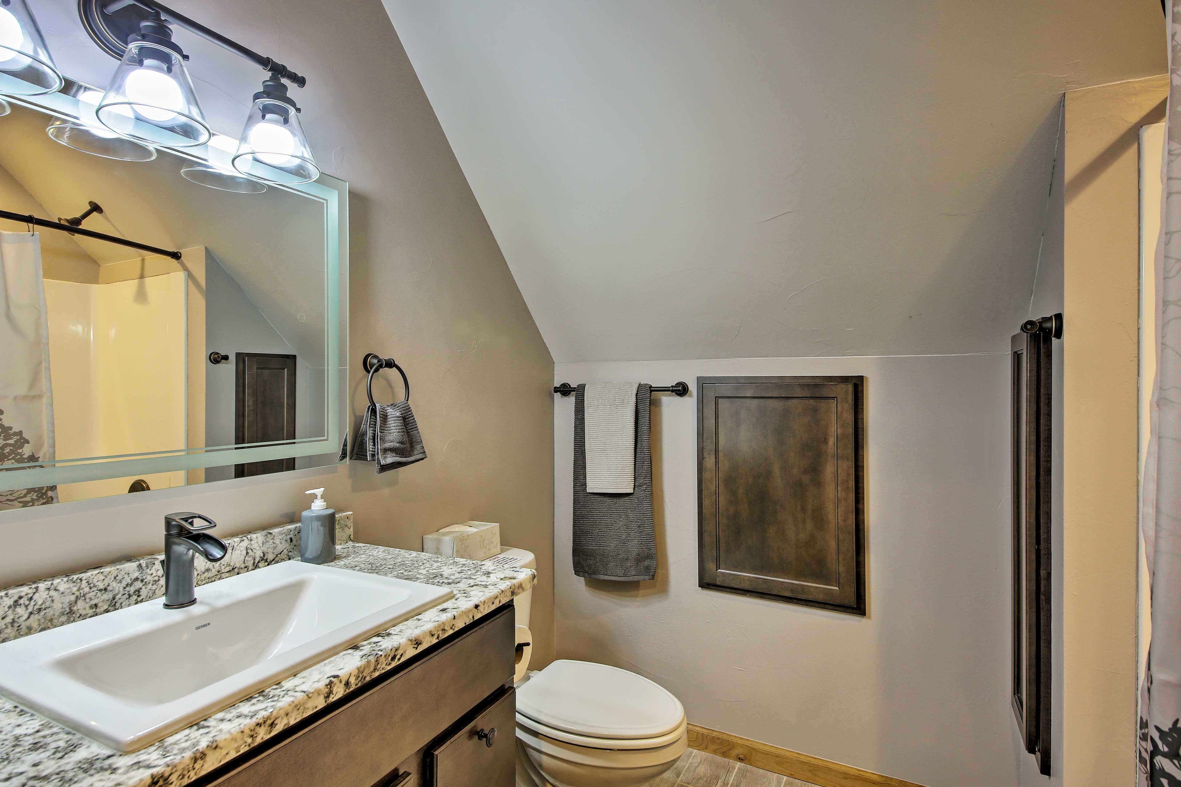 The second full bathroom includes a shower/tub combo.