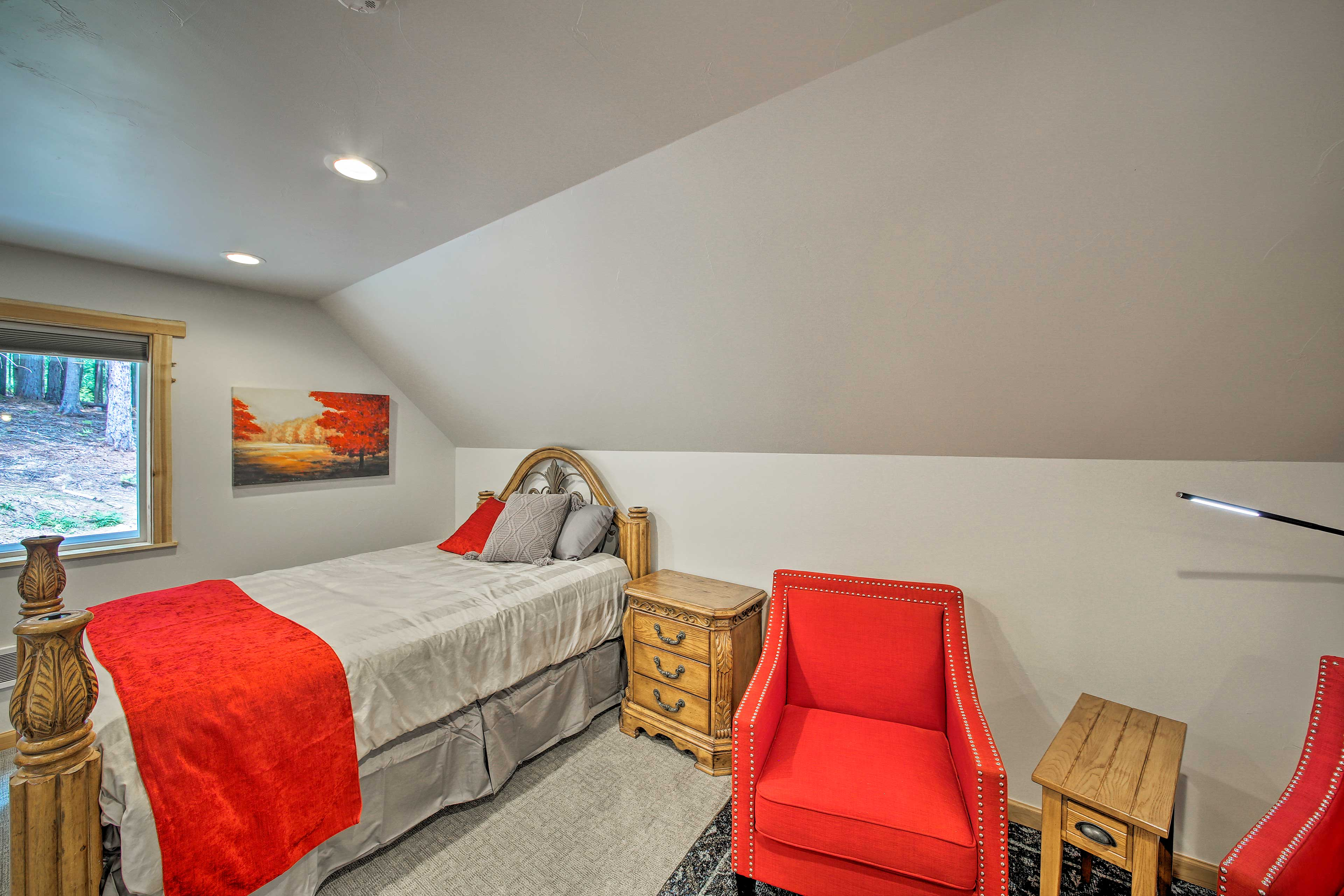 The second bedroom features another queen bed.