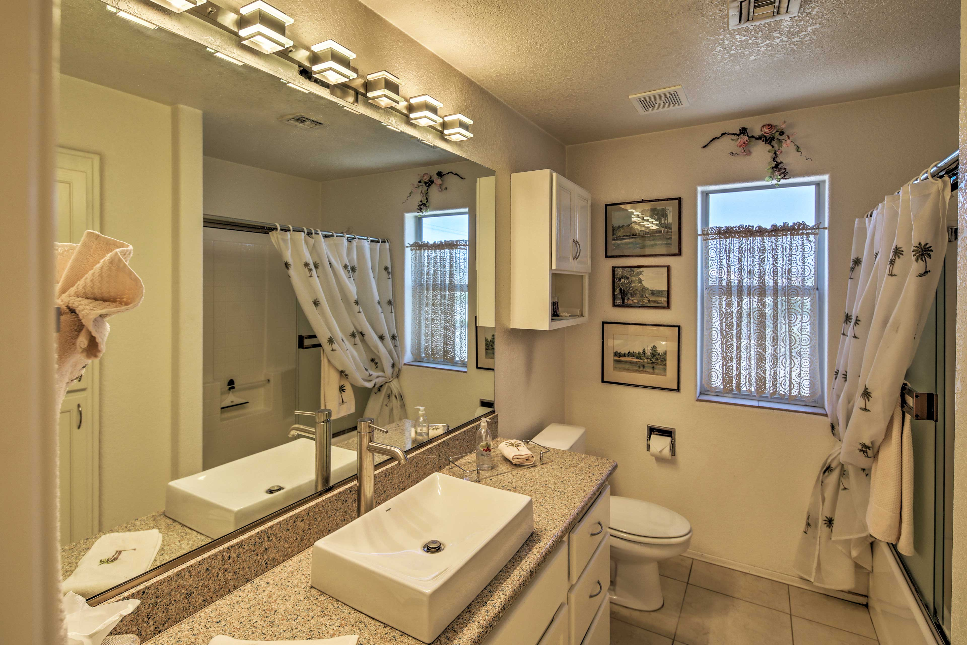Change into your comfy clothes after showering in this second bathroom.