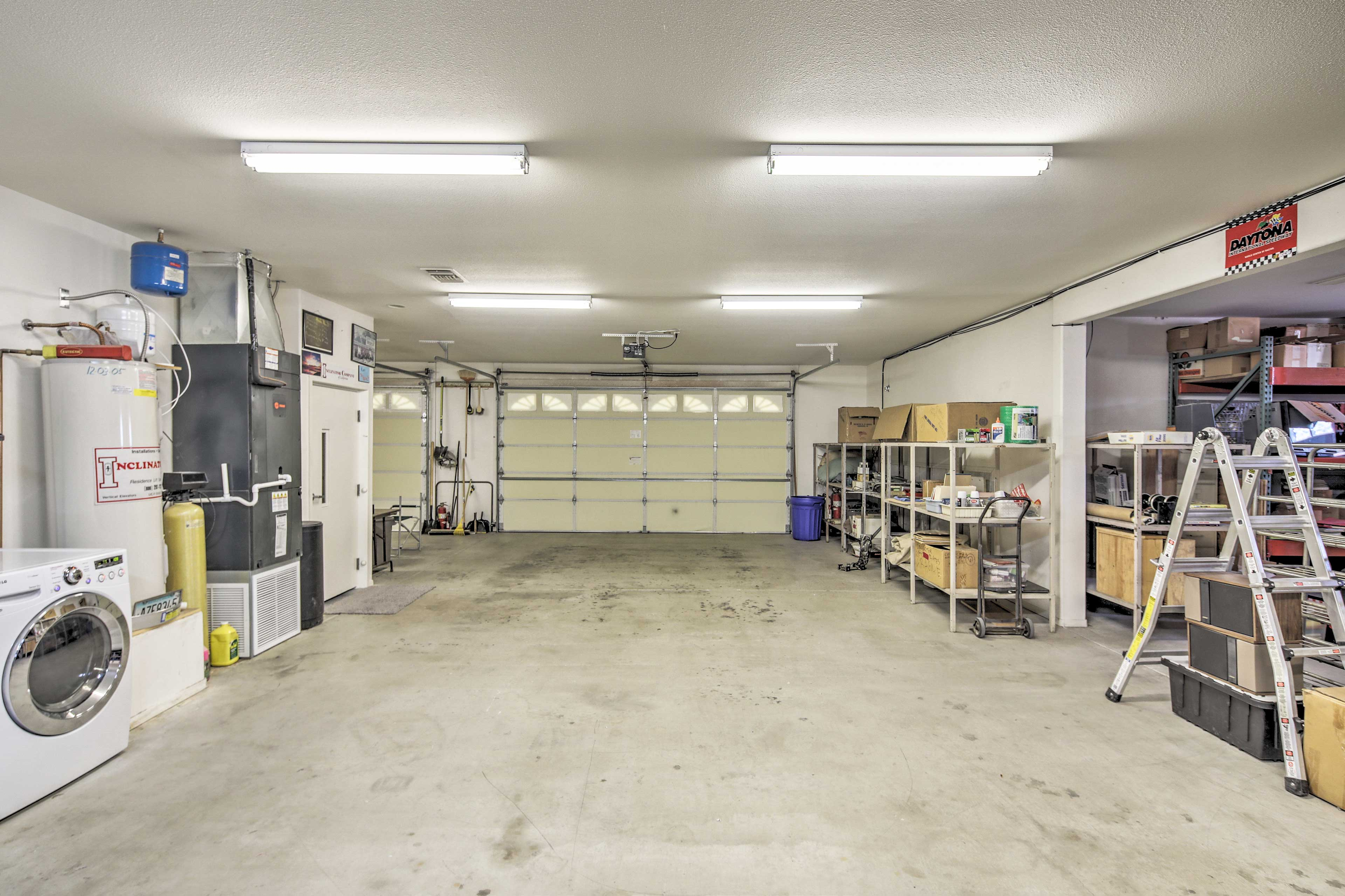 The garage has plenty of space for vehicles or a boat.