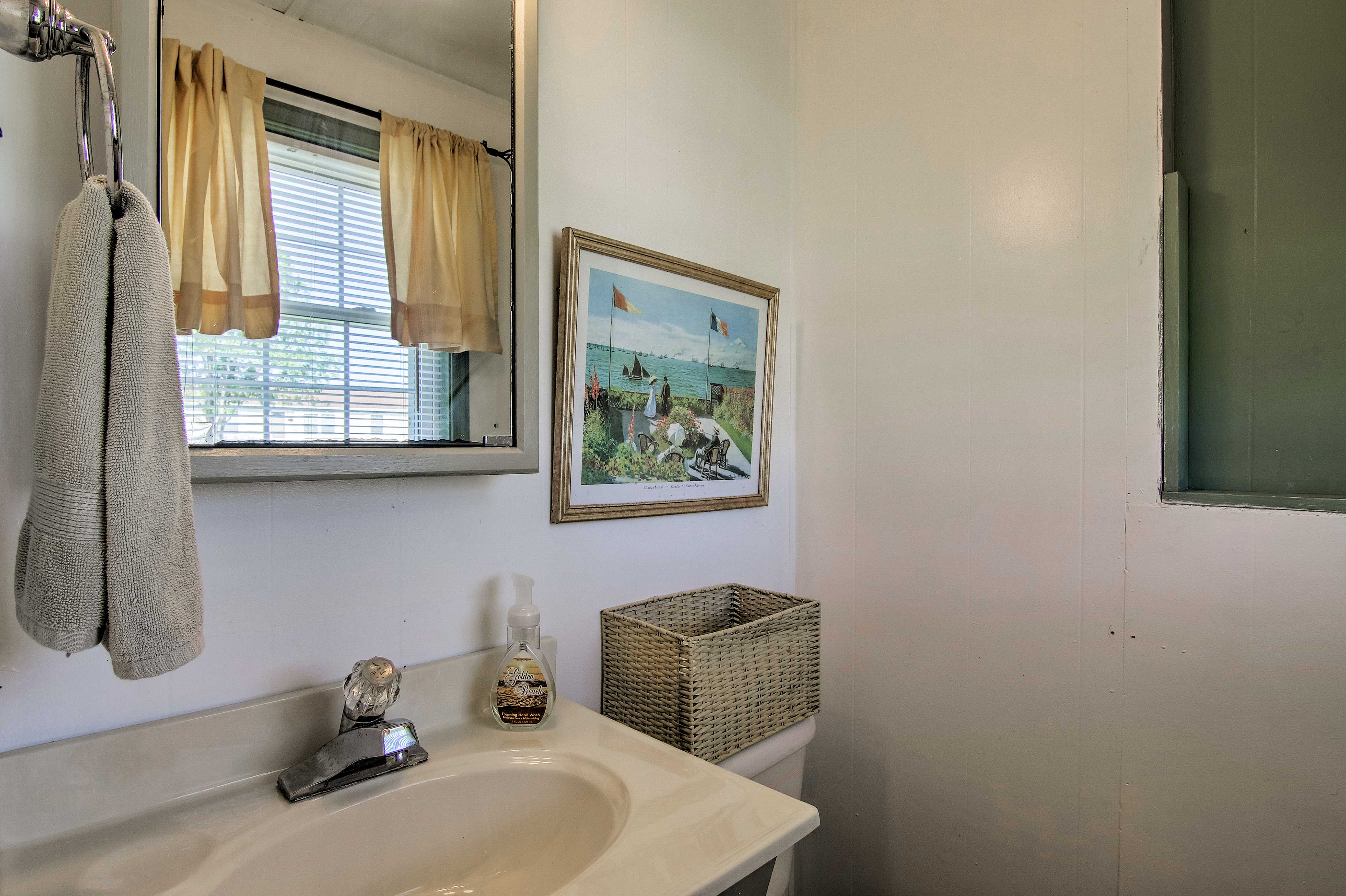 The en-suite half bathroom makes getting ready easy!