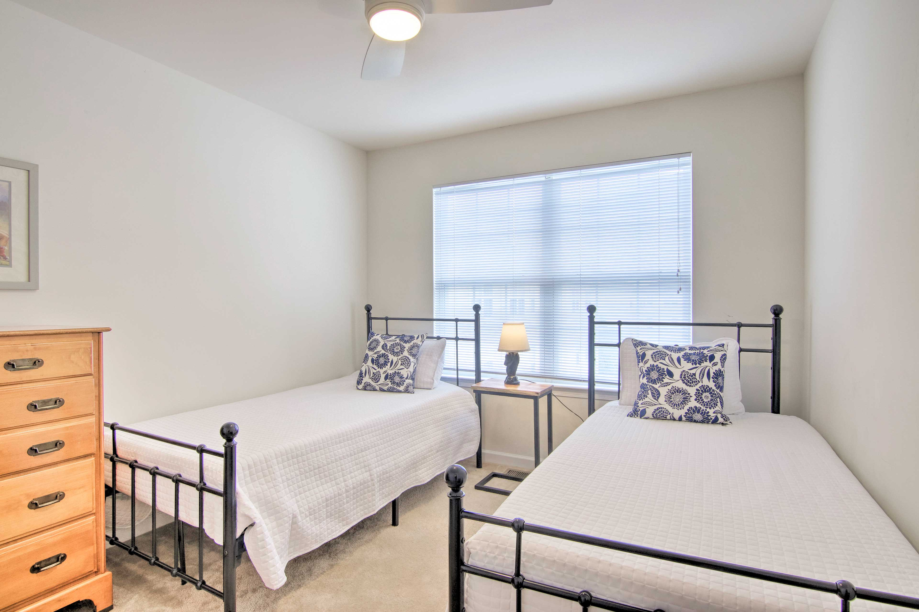 Sleep side by side in these 2 cozy twin beds.