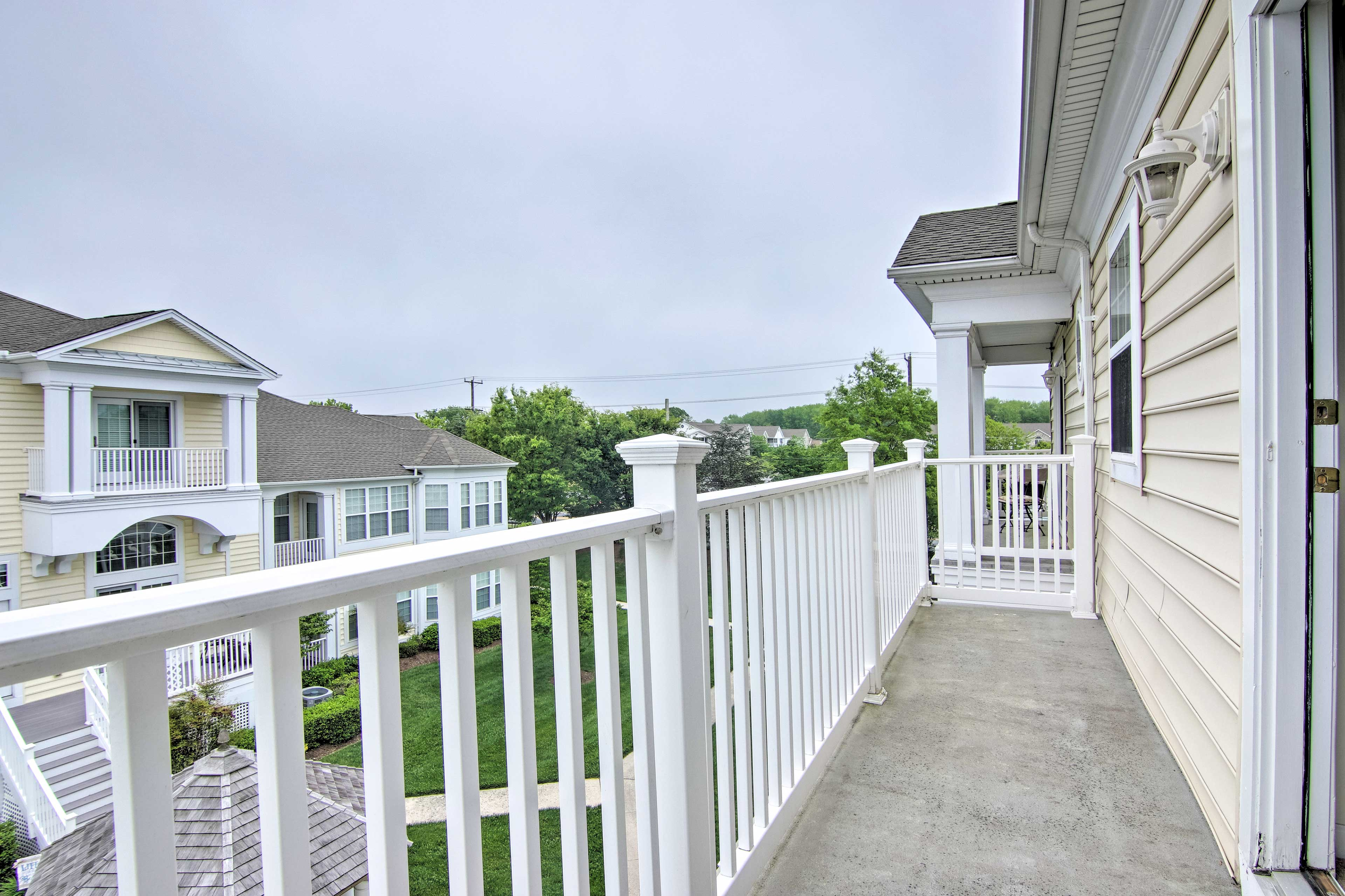 Take in the neighborhood from the home's balcony.