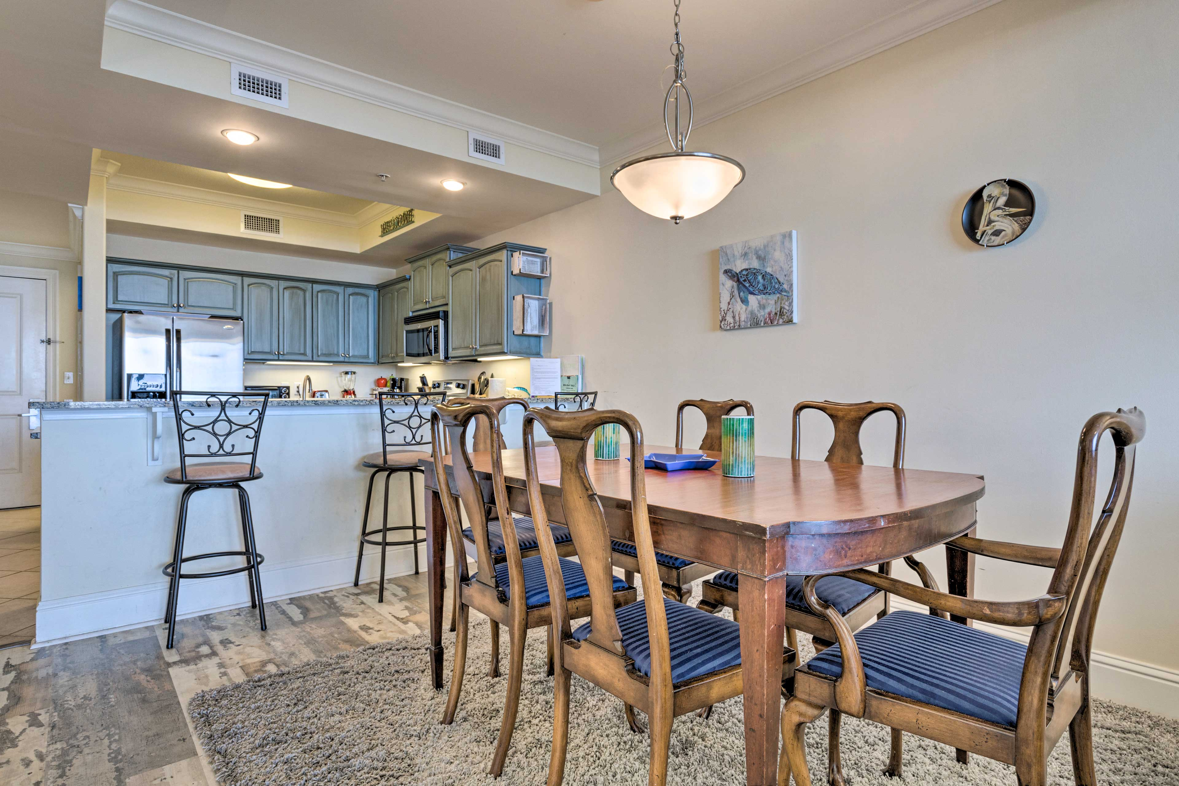 Eat the dining table or enjoy a meal at the breakfast bar.