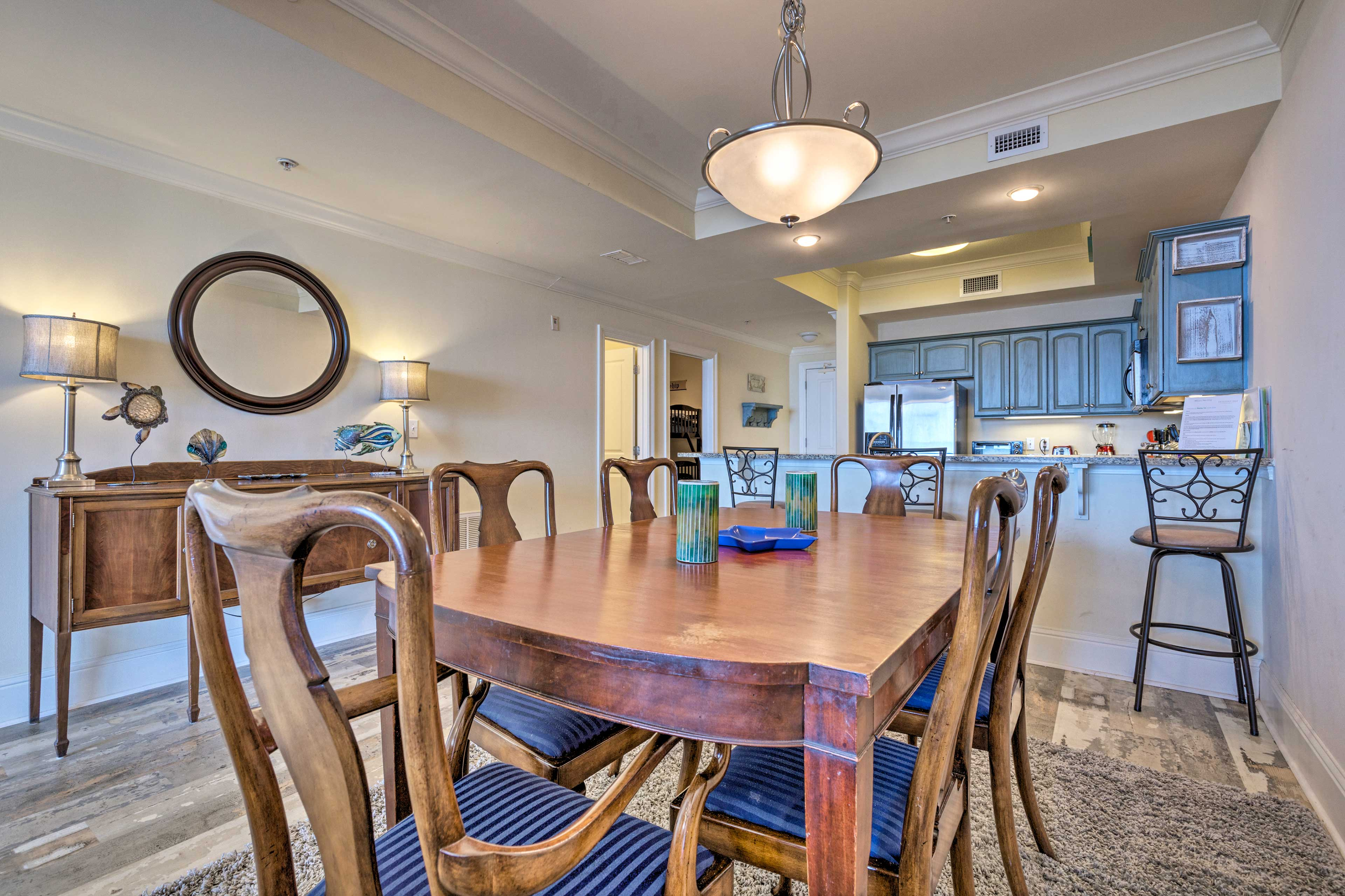 Gather around the 6-person dining table to enjoy meals with the family.