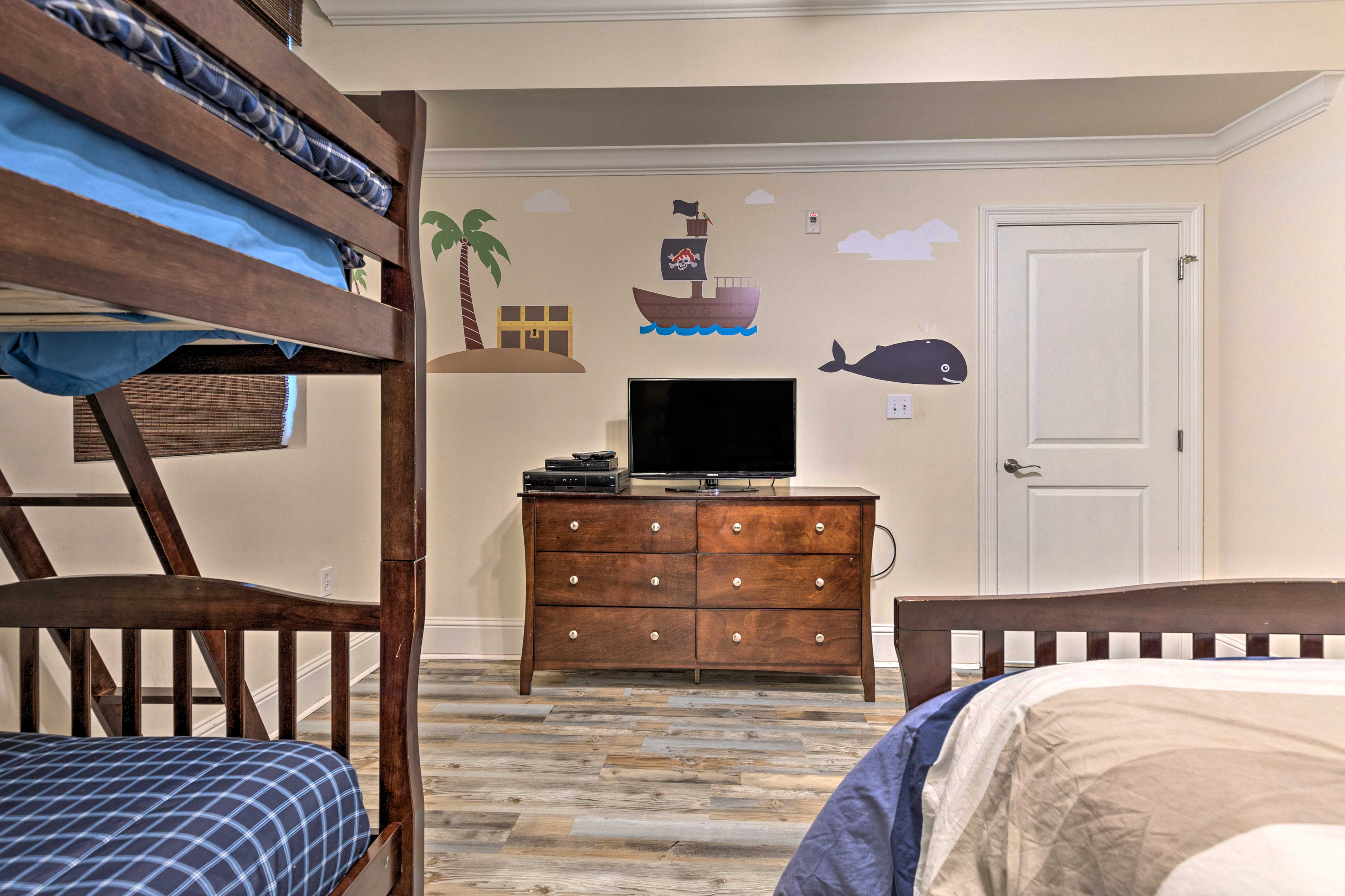 This bedroom features a twin bunk bed and full bed.