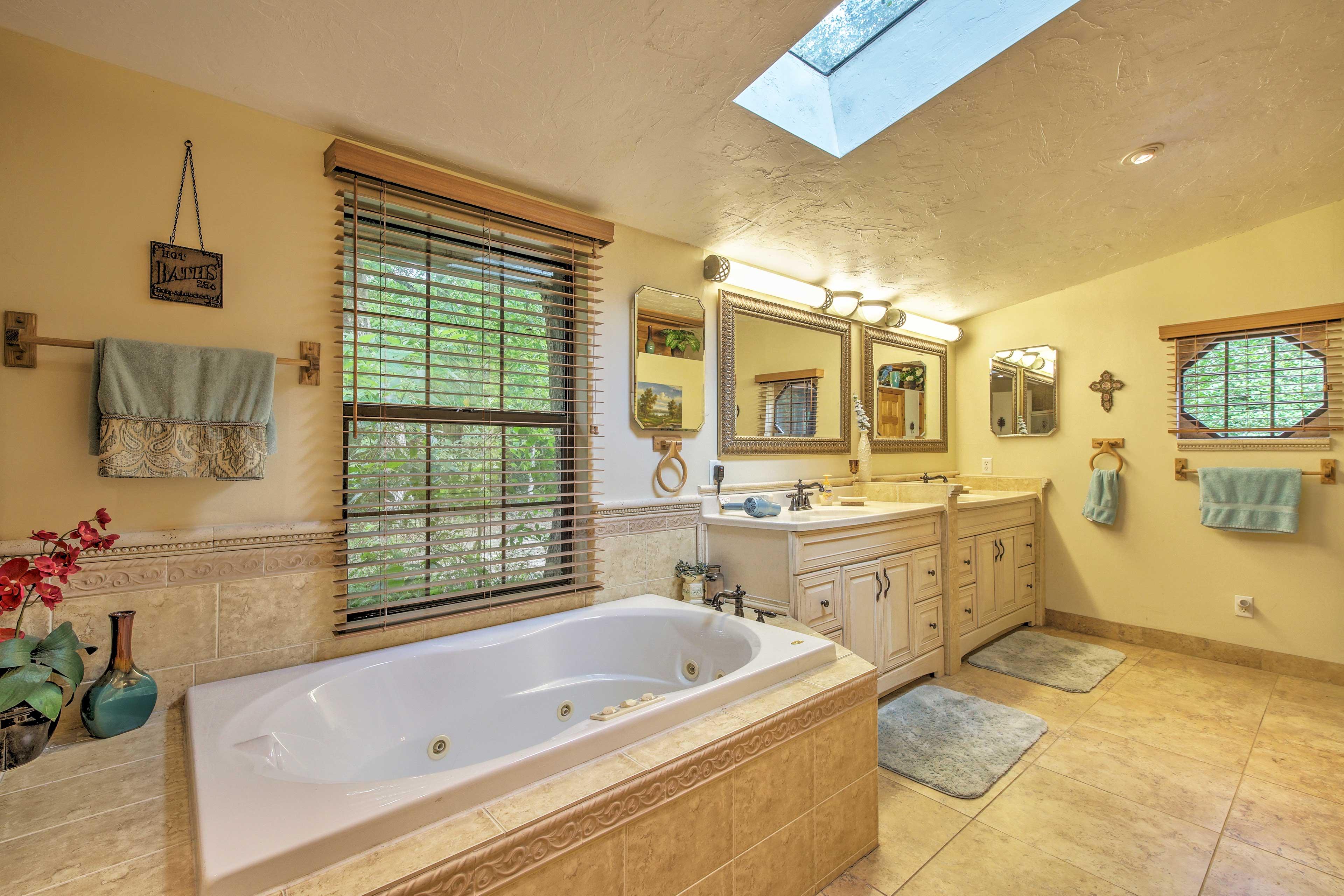 Enjoy a relaxing soak in the jacuzzi bathtub.