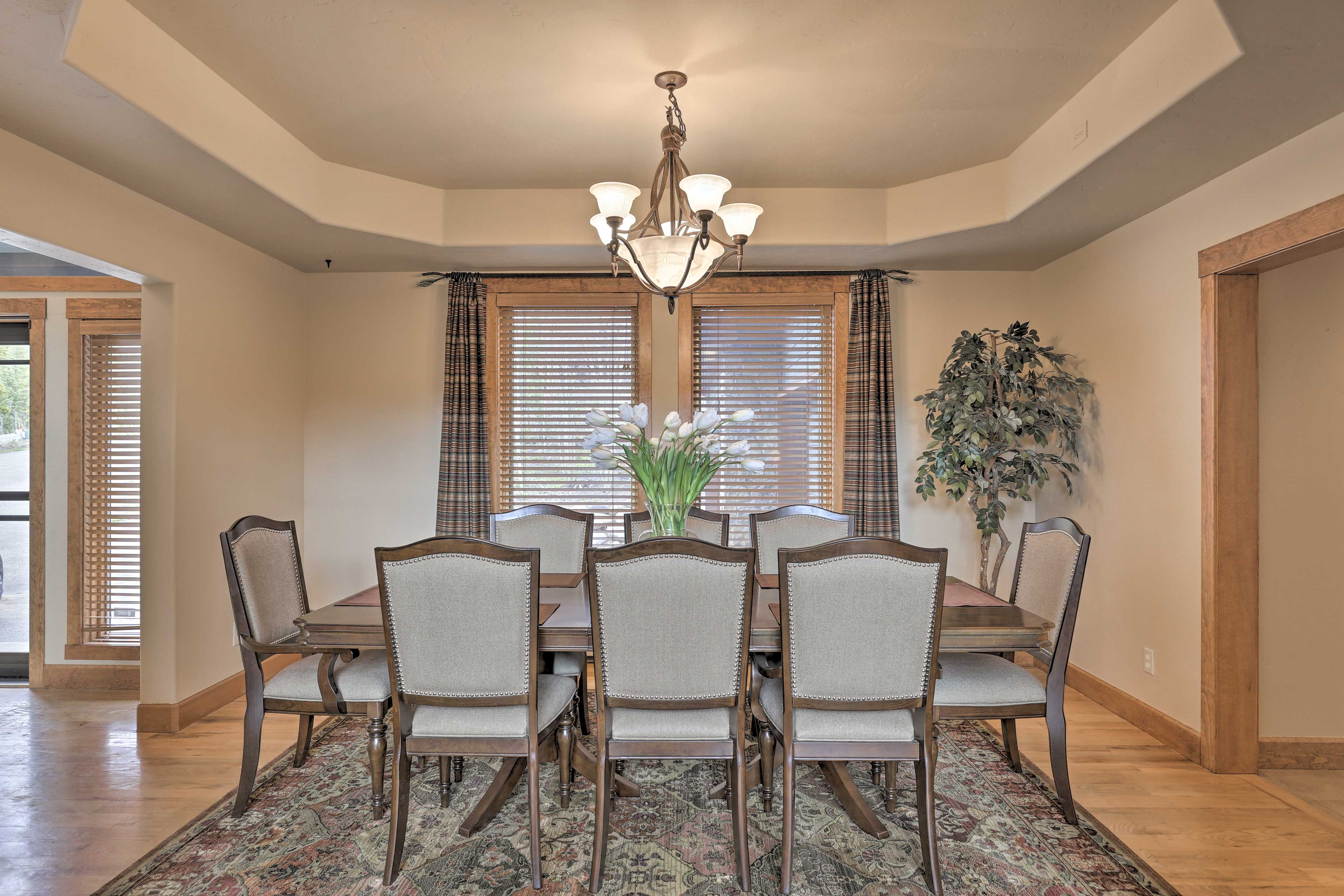 Host family dinners at the banquet-style dining table.