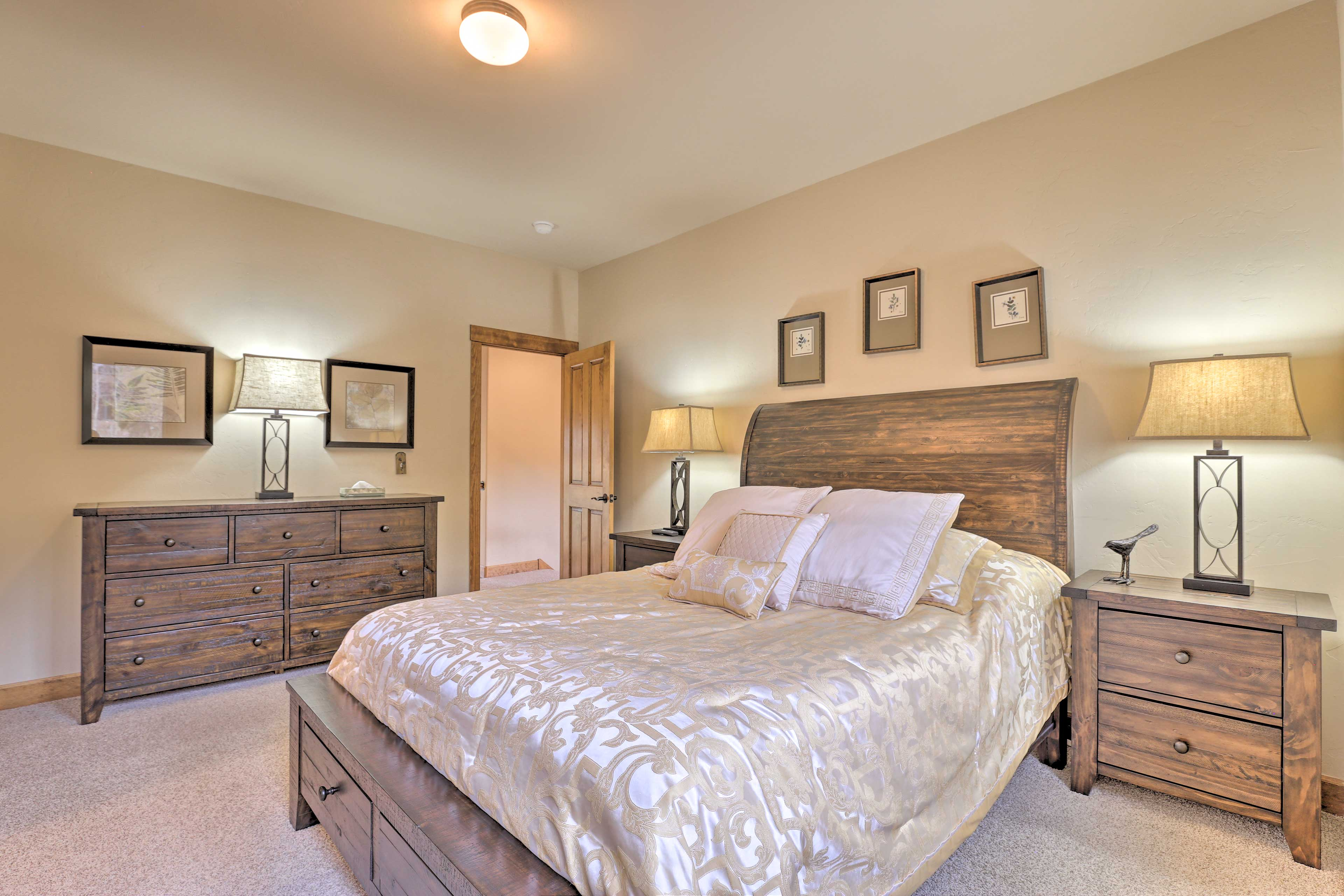 The second bedroom features a plush queen-sized bed.