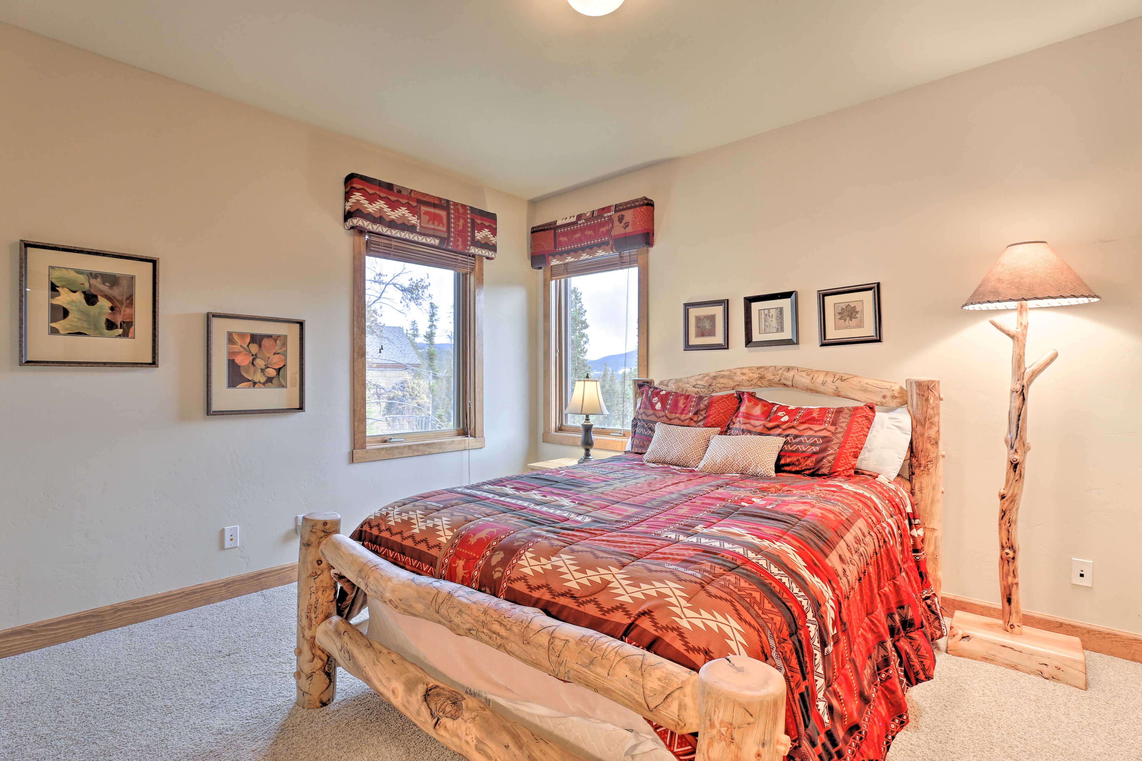Two guests can snooze in this adorable queen bed!