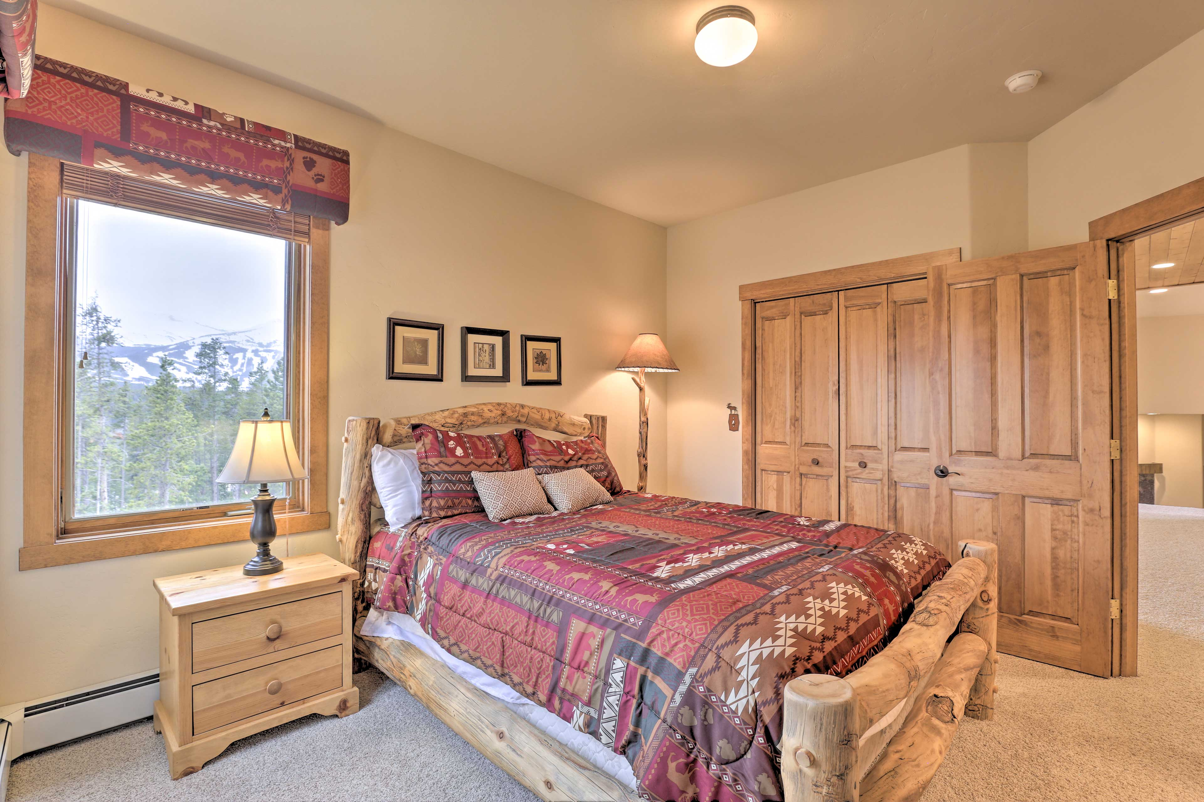 The third bedroom's queen bed features an endearing log bed frame.