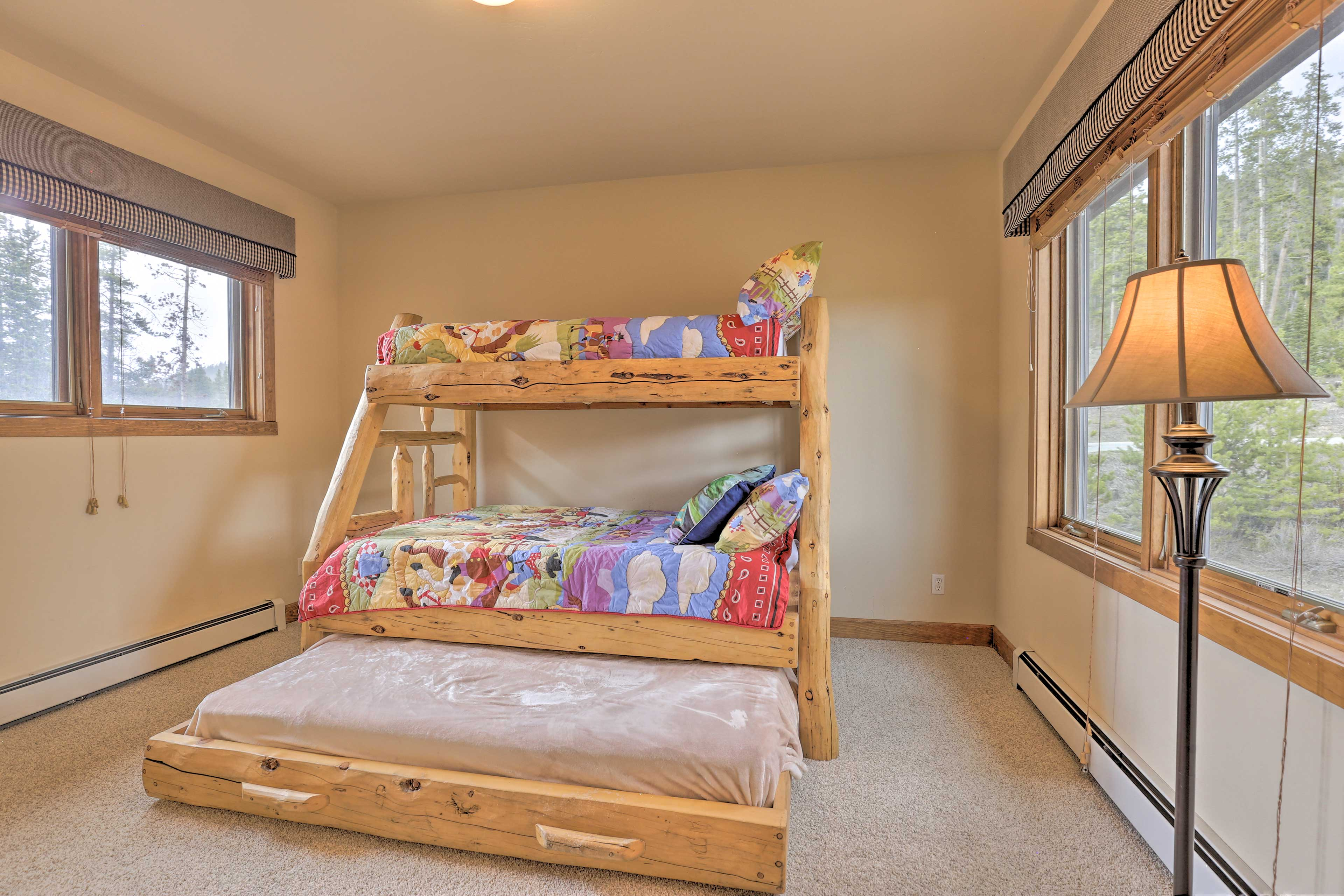 This room includes a twin/full bunk bed with a twin trundle.