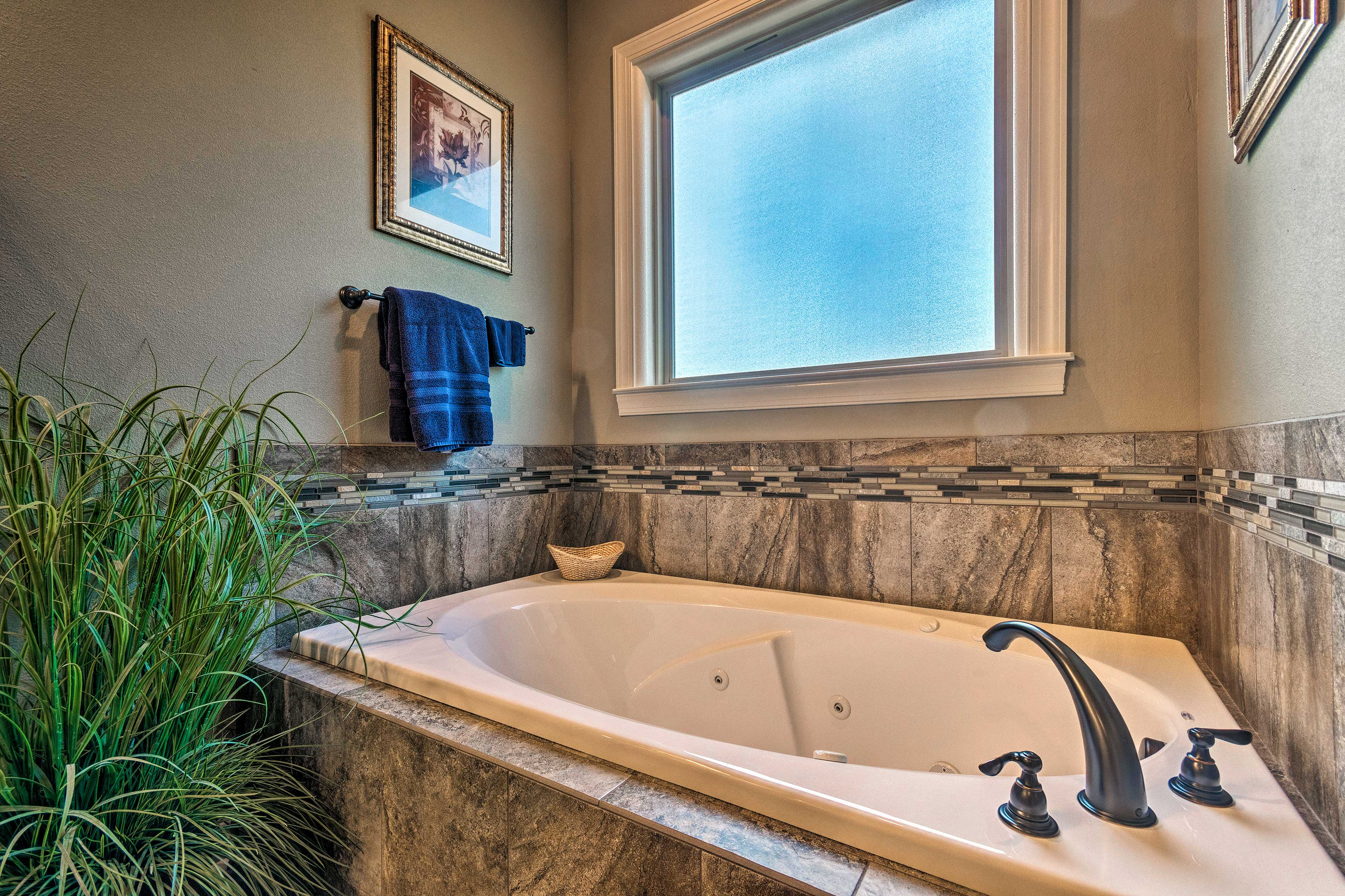 The master bathroom also features a jacuzzi tub.