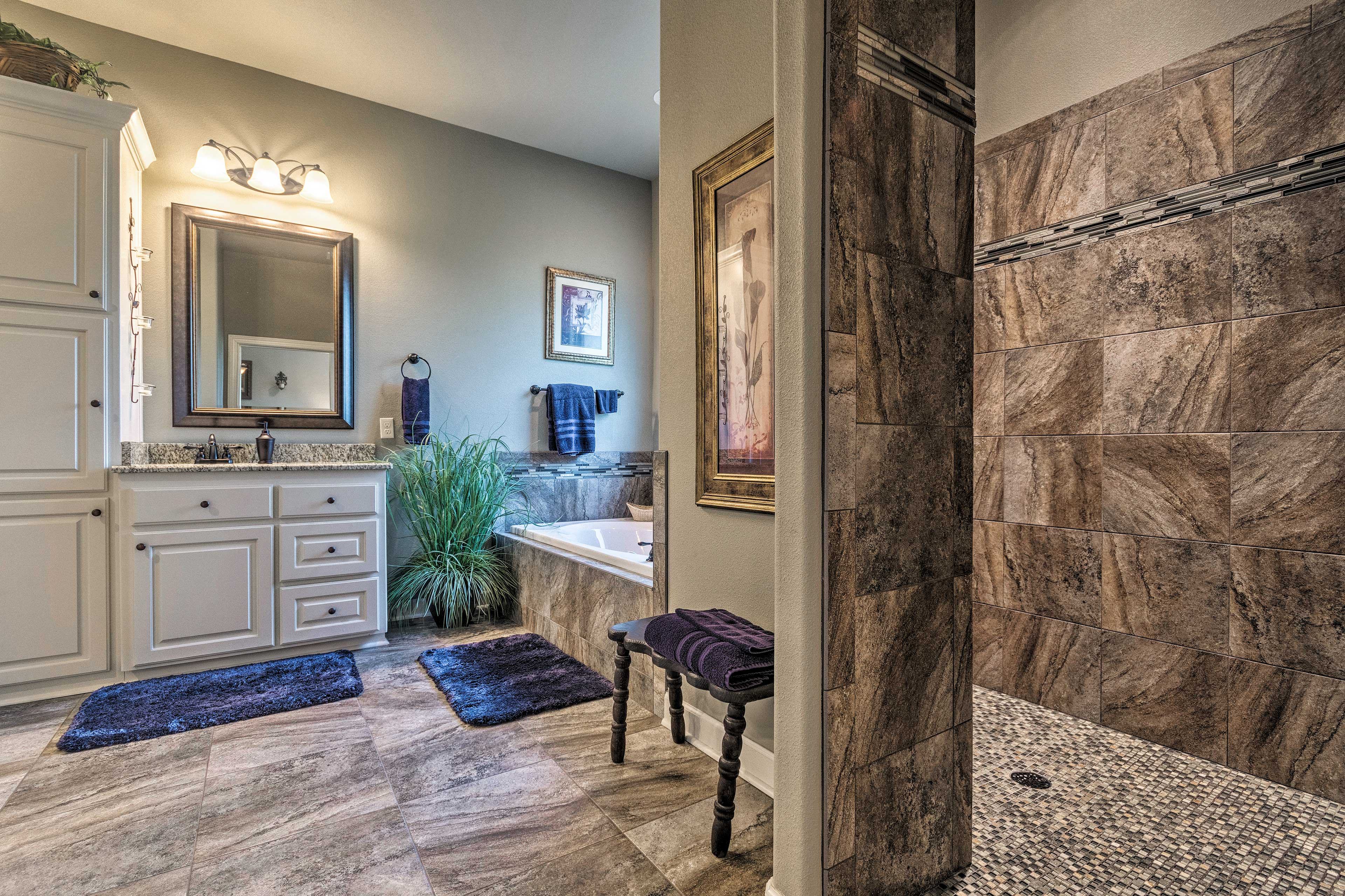 Rinse off the day in this breathtaking walk-in shower.