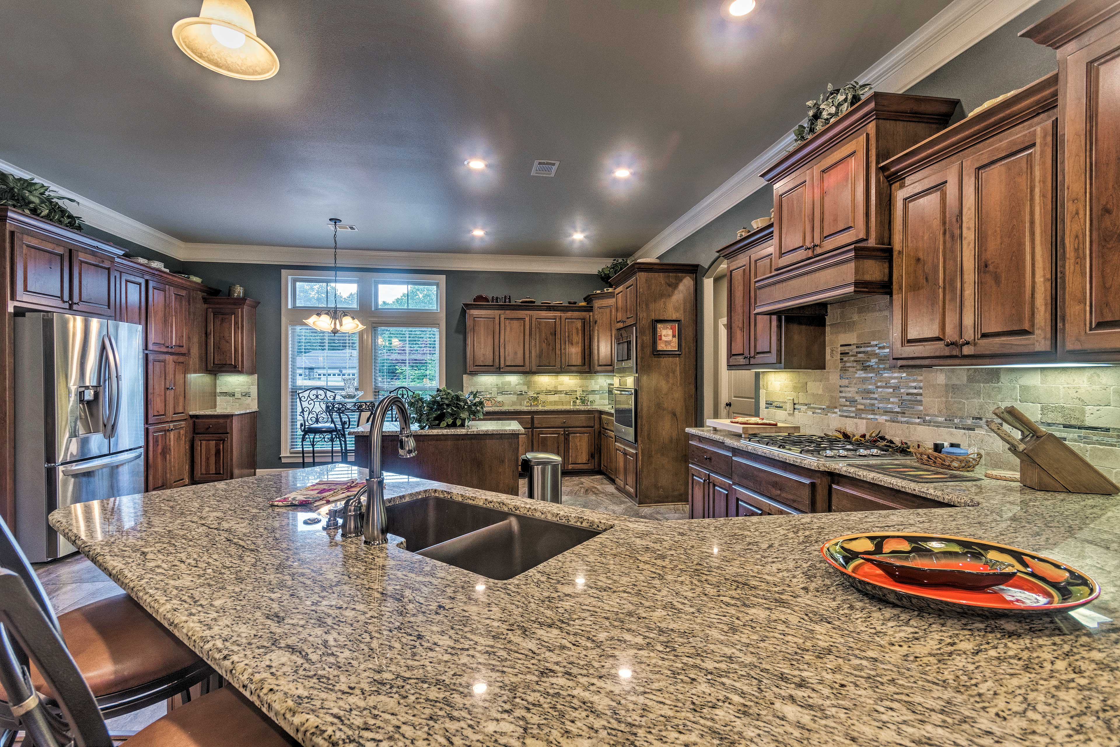 The fully equipped kitchen is sure to impress even the most seasoned chef.