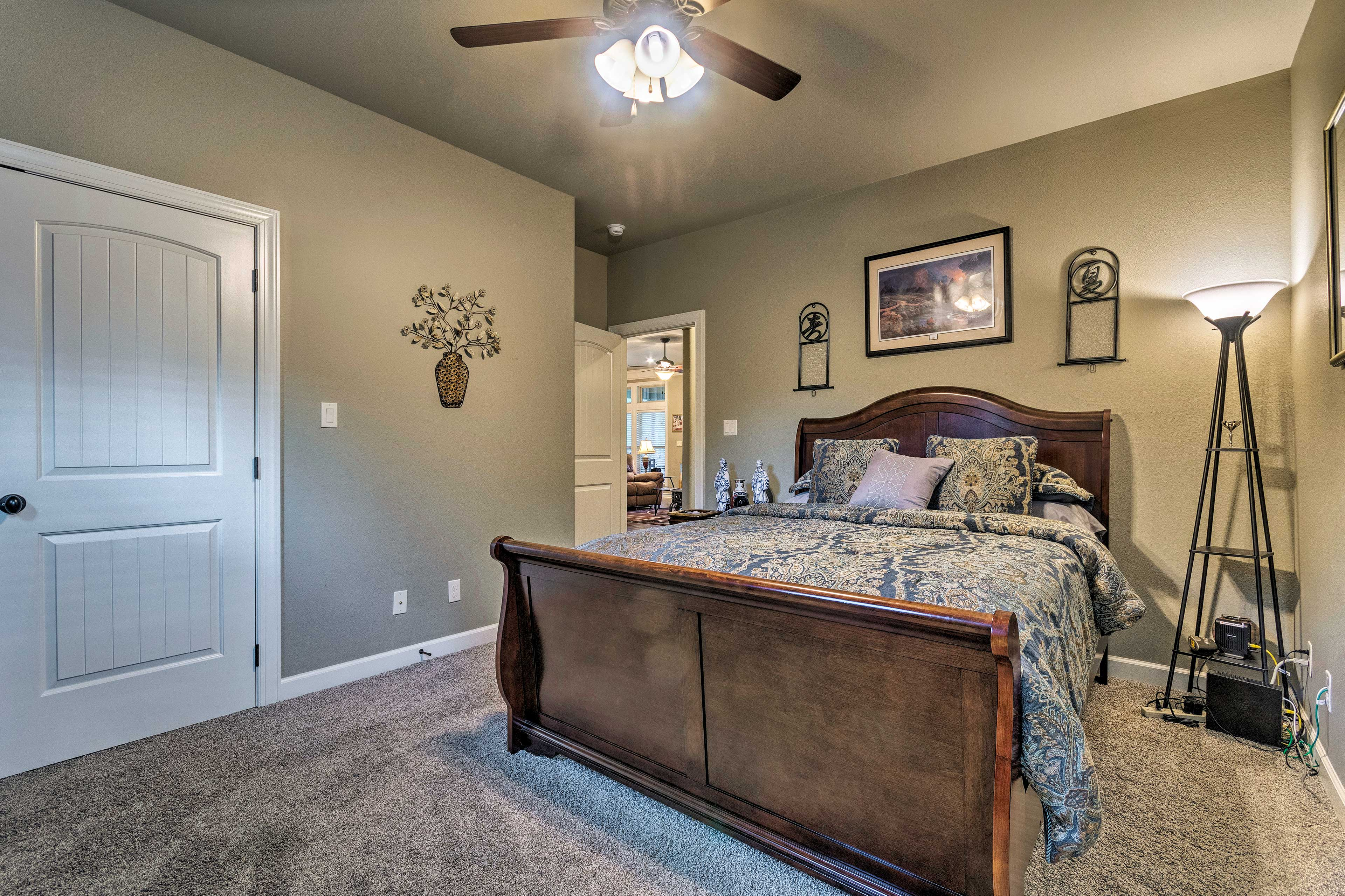 Two guests can comfortably sleep in this queen bed.