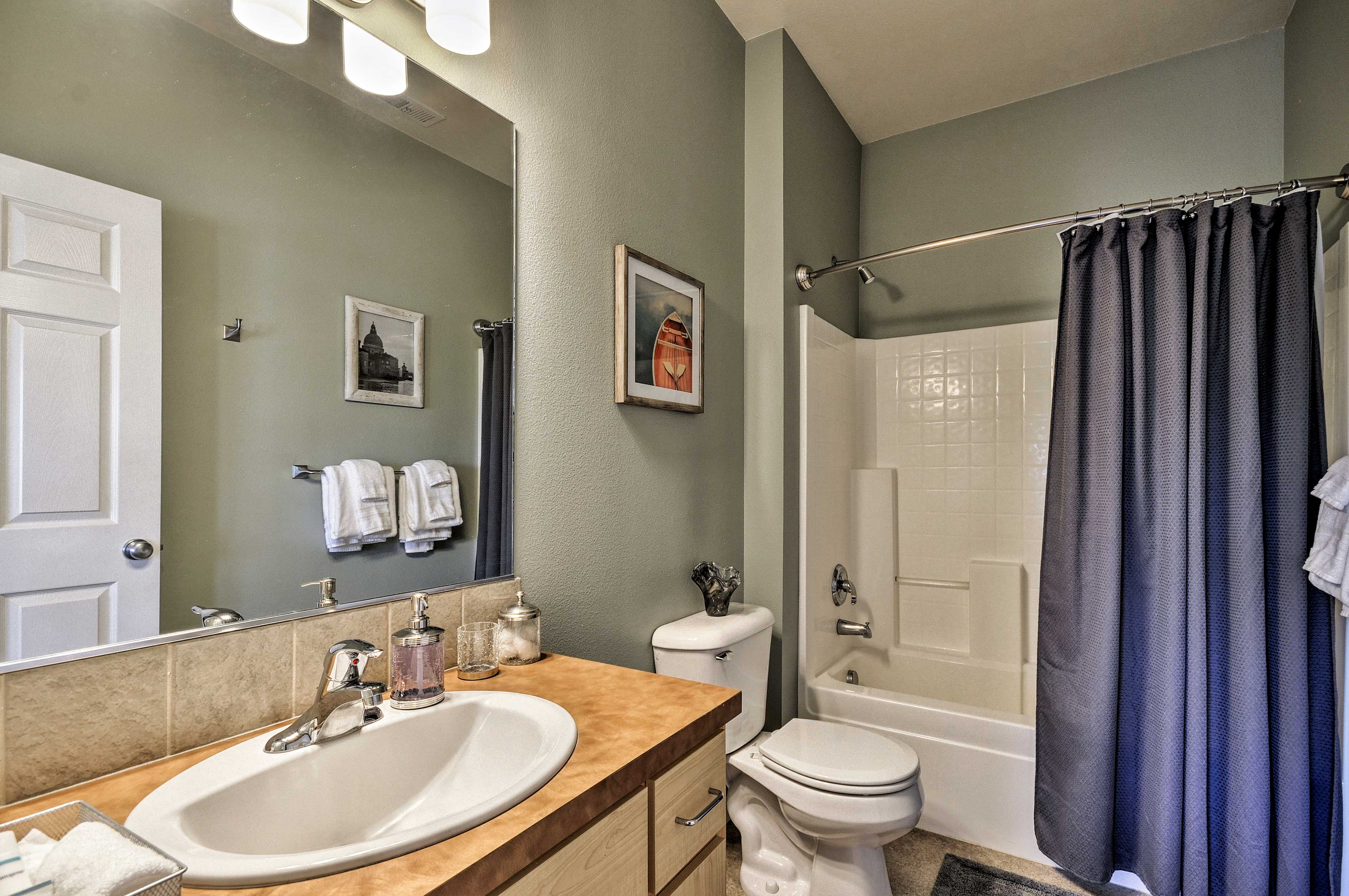 In the en-suite bath, you will find a shower/tub combo.