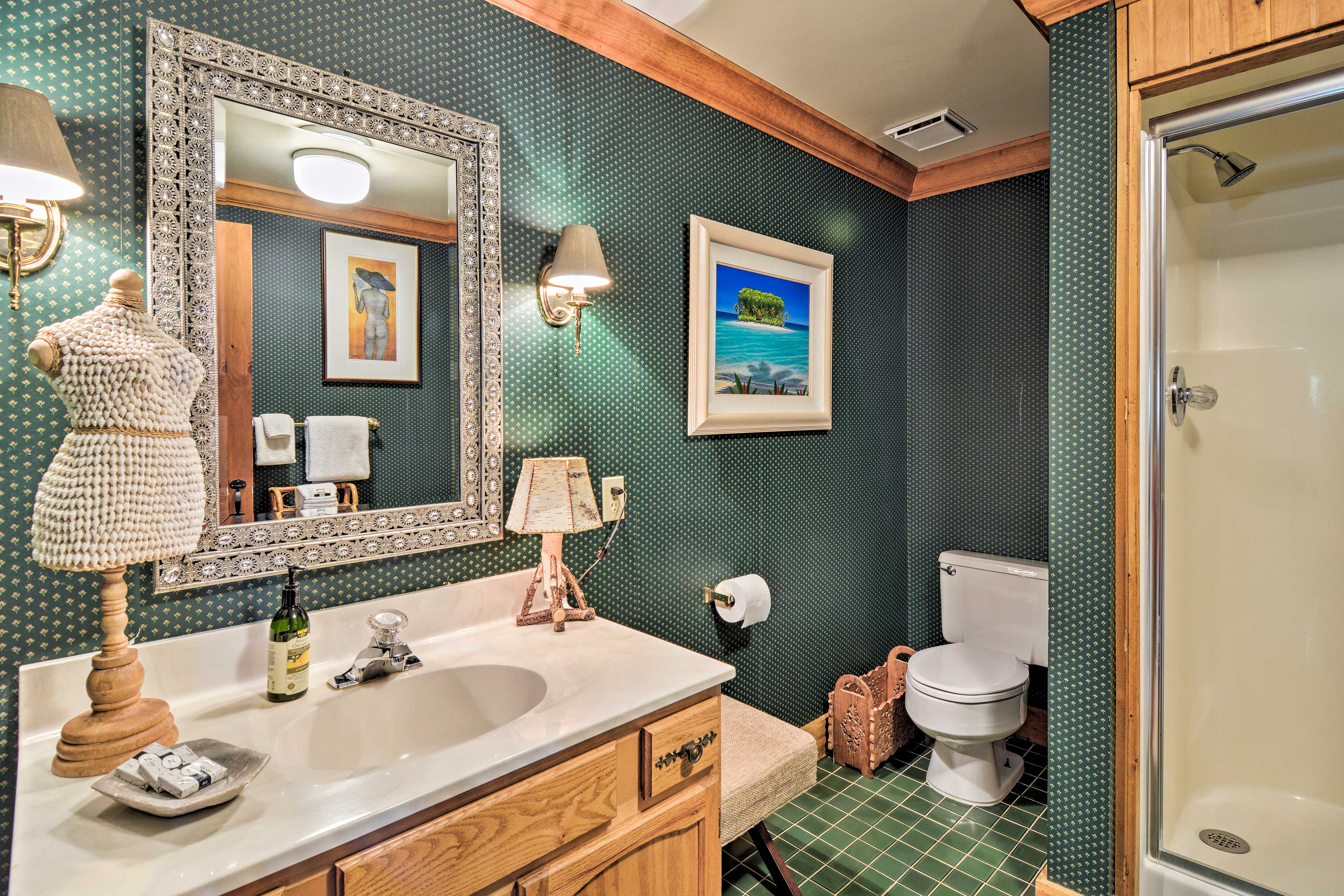 The downstairs bathroom is home to a shower to rinse of and freshen up.
