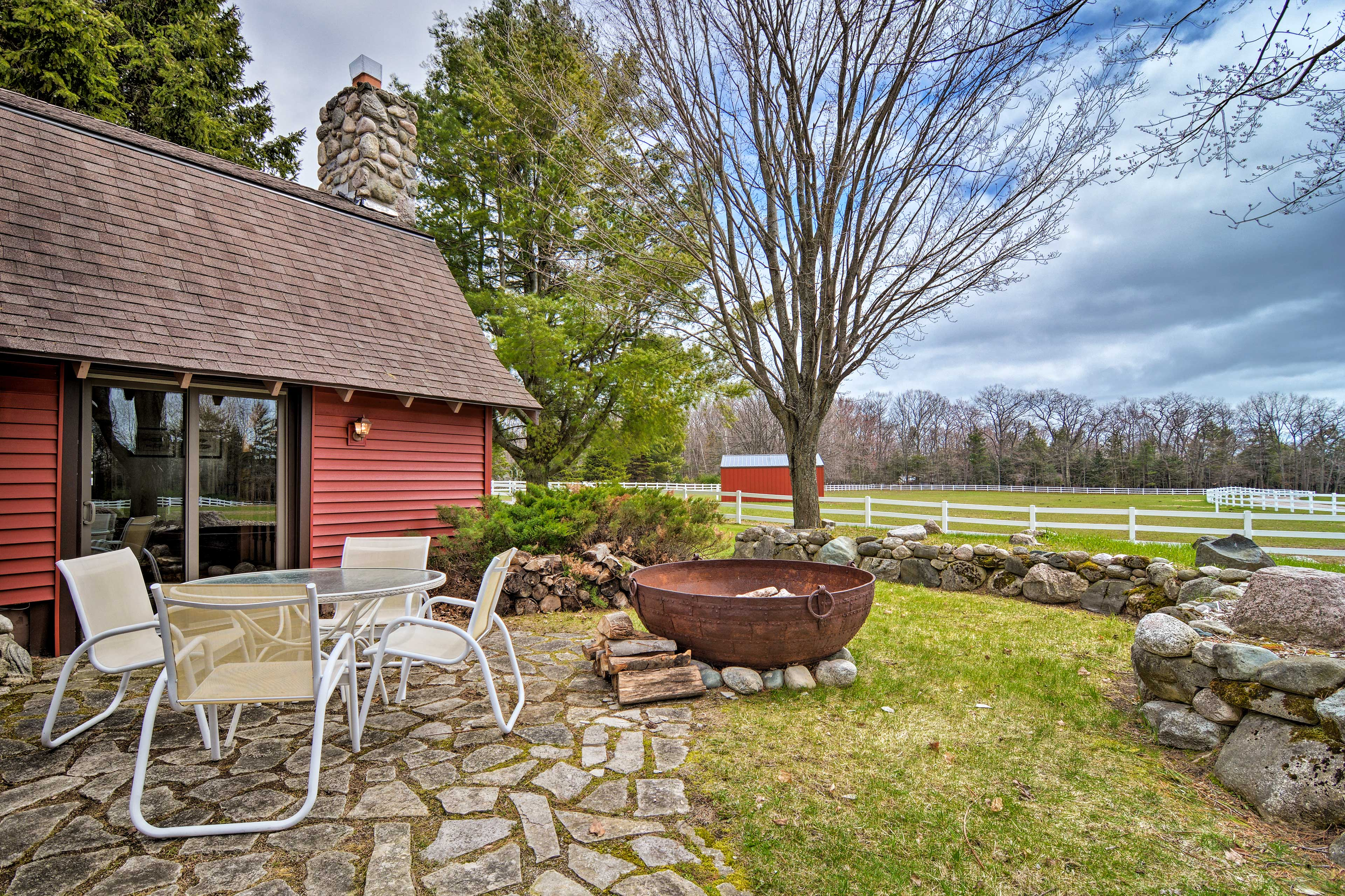 Step outside where a fire pit and patio await.