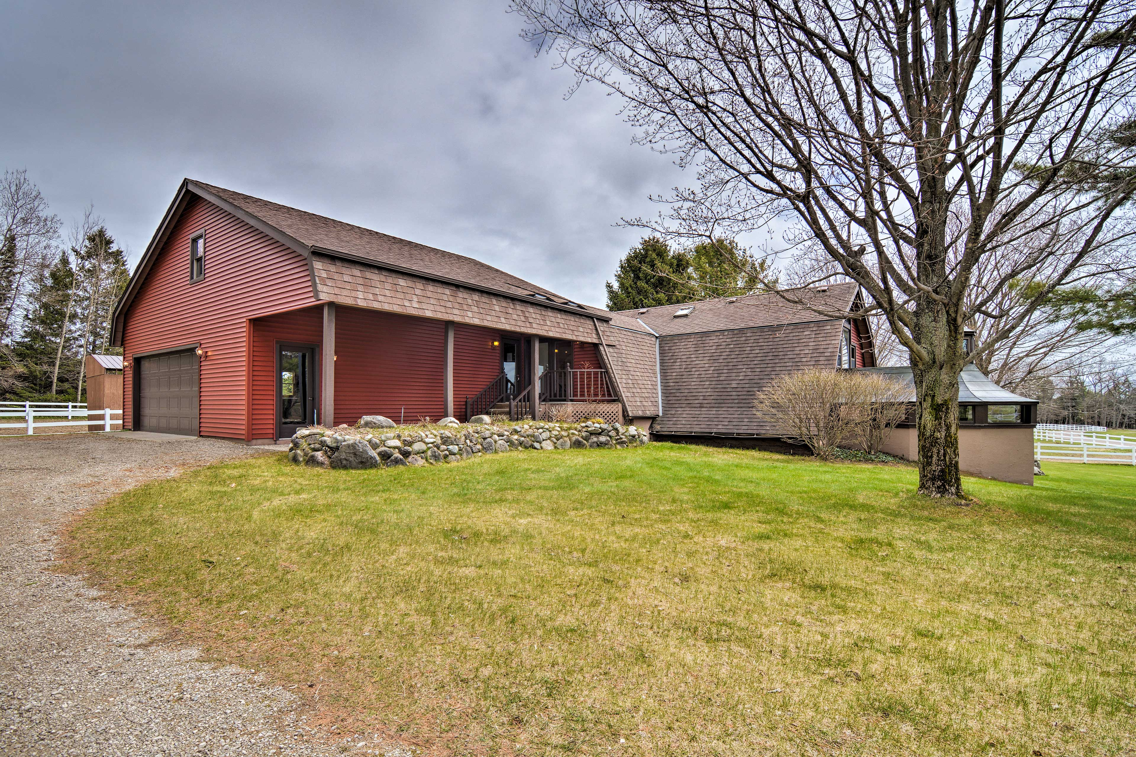 The garage and driveway provide ample parking for guests.