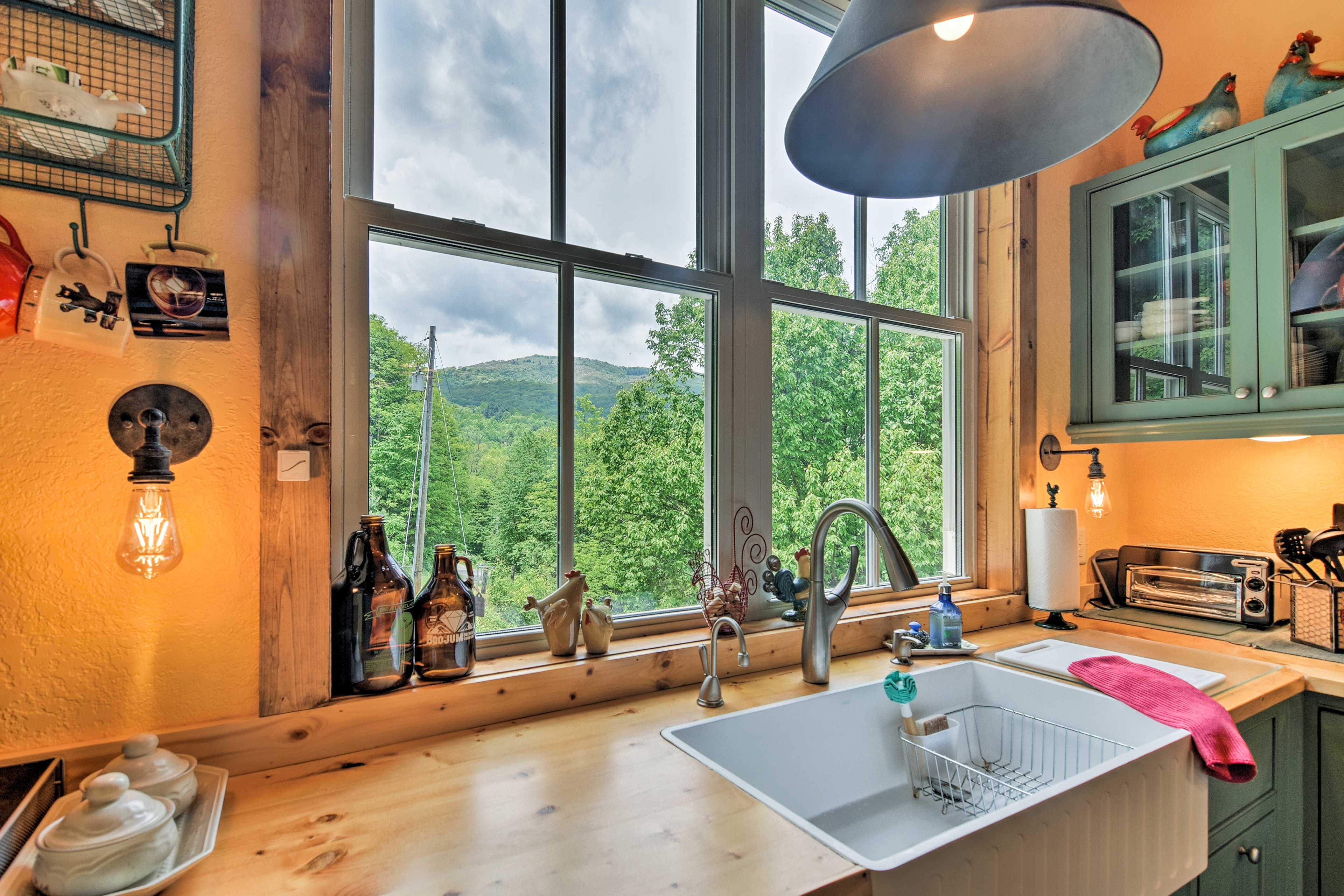 You'll find the kitchen chock-full of dishware, cookware, & other amenities.