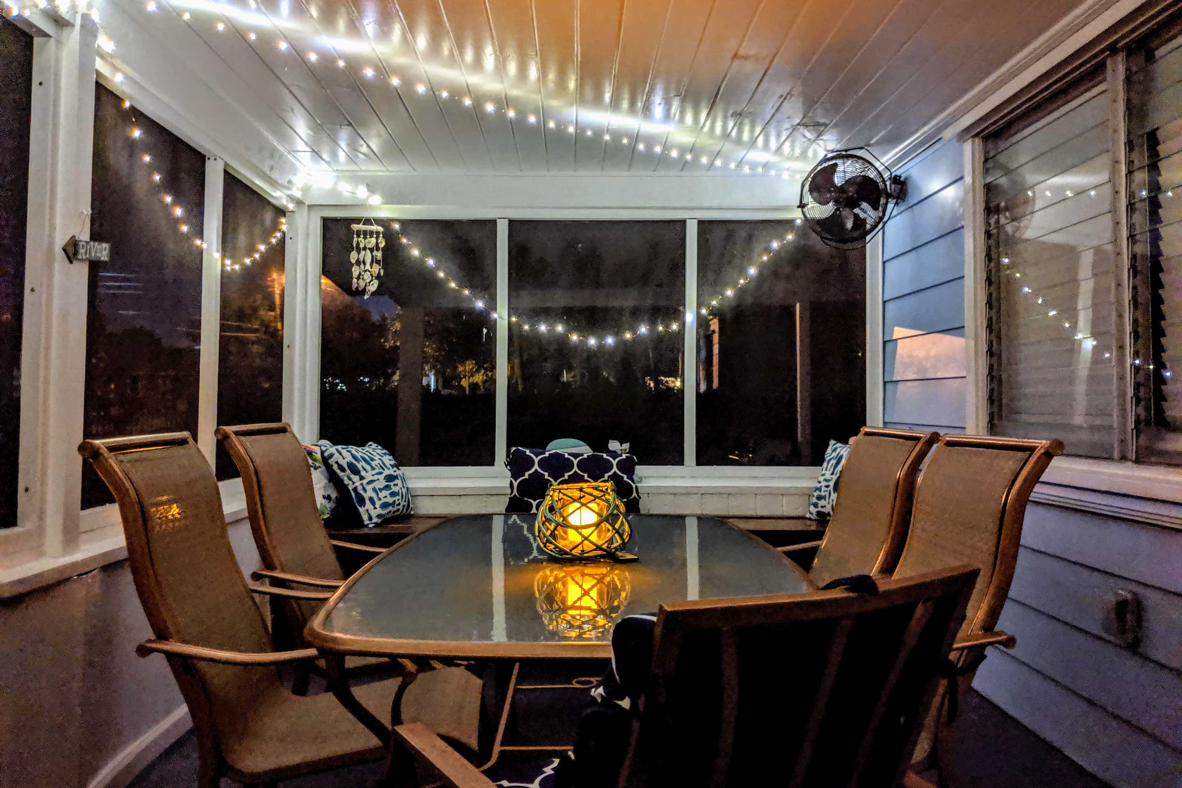 Twinkly lights illuminate the porch, perfect for nighttime chats.