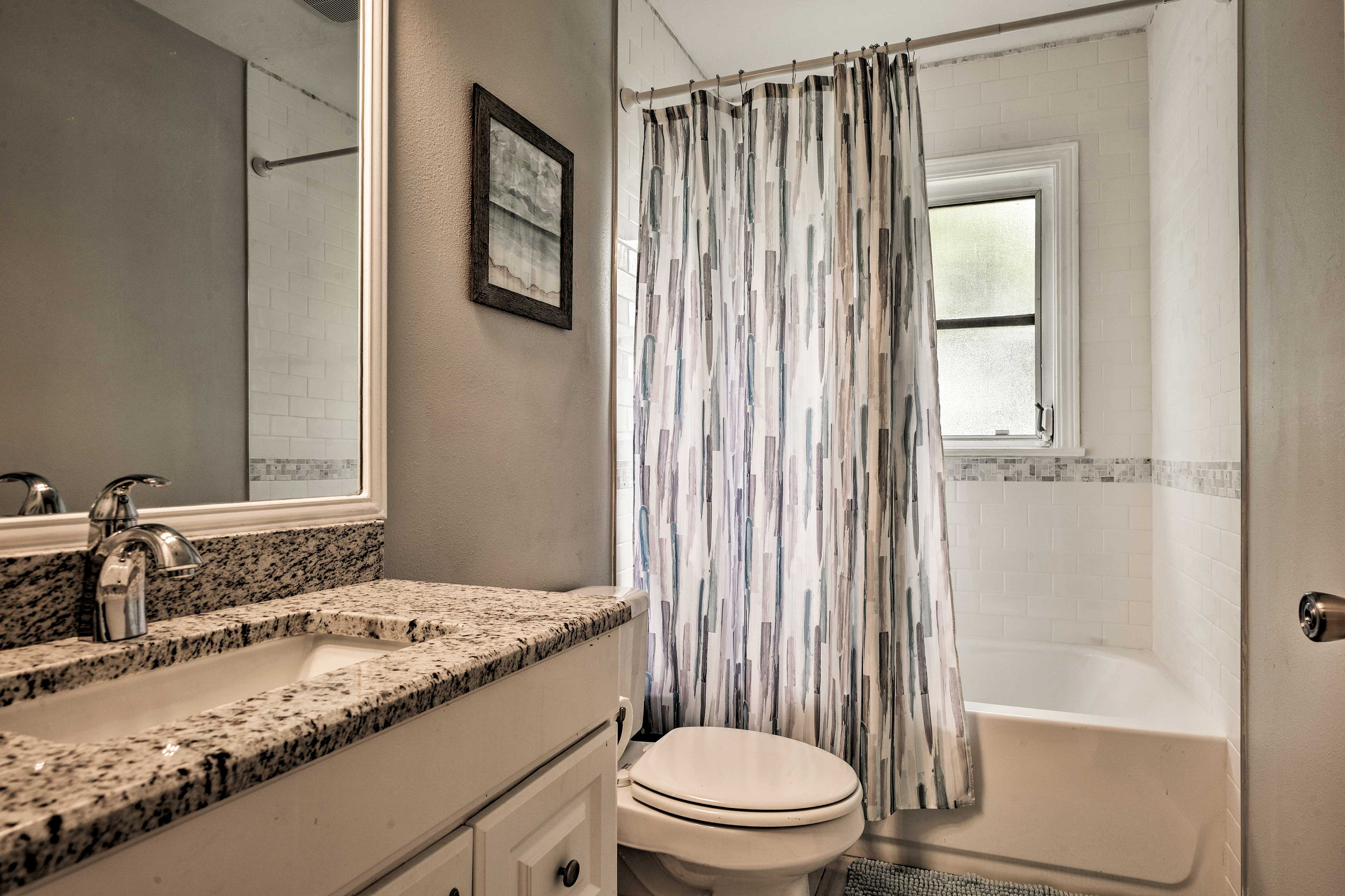 Step into the full bathroom to rinse off after a long day.