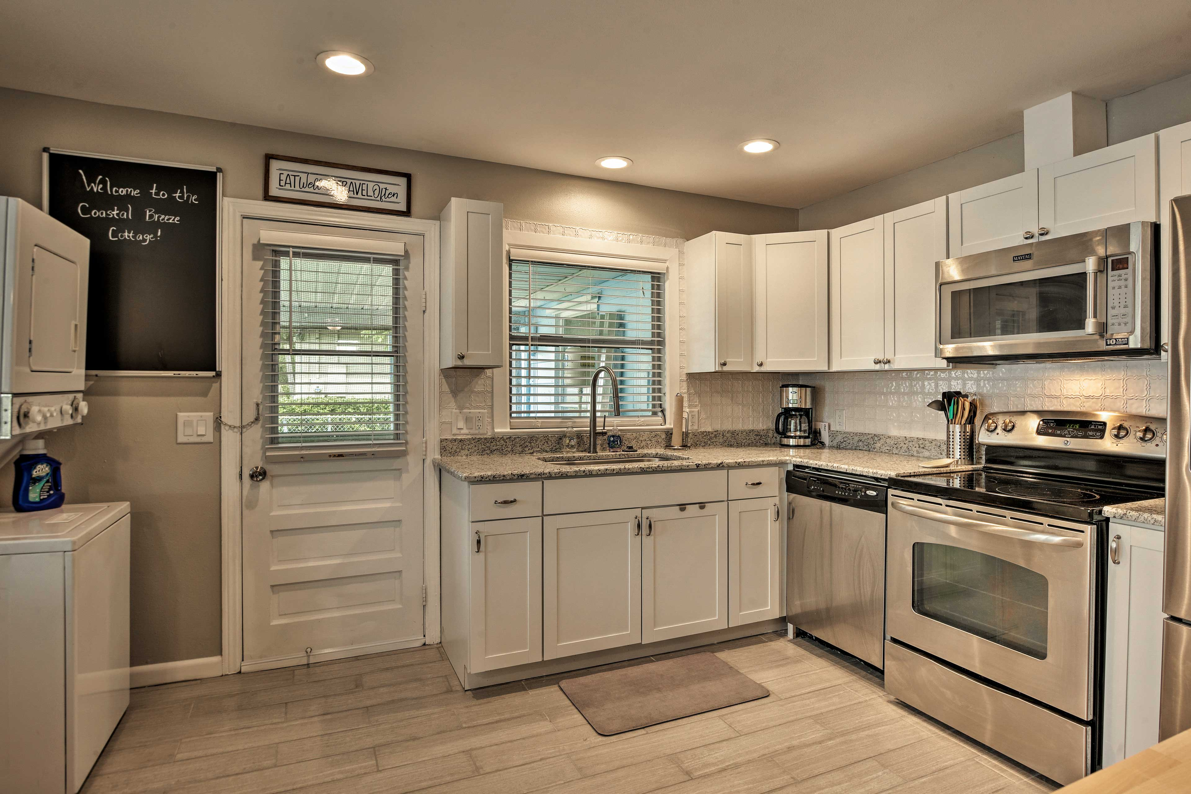 The 'Coastal Breeze Cottage' also boasts a bright, fully-equipped kitchen.