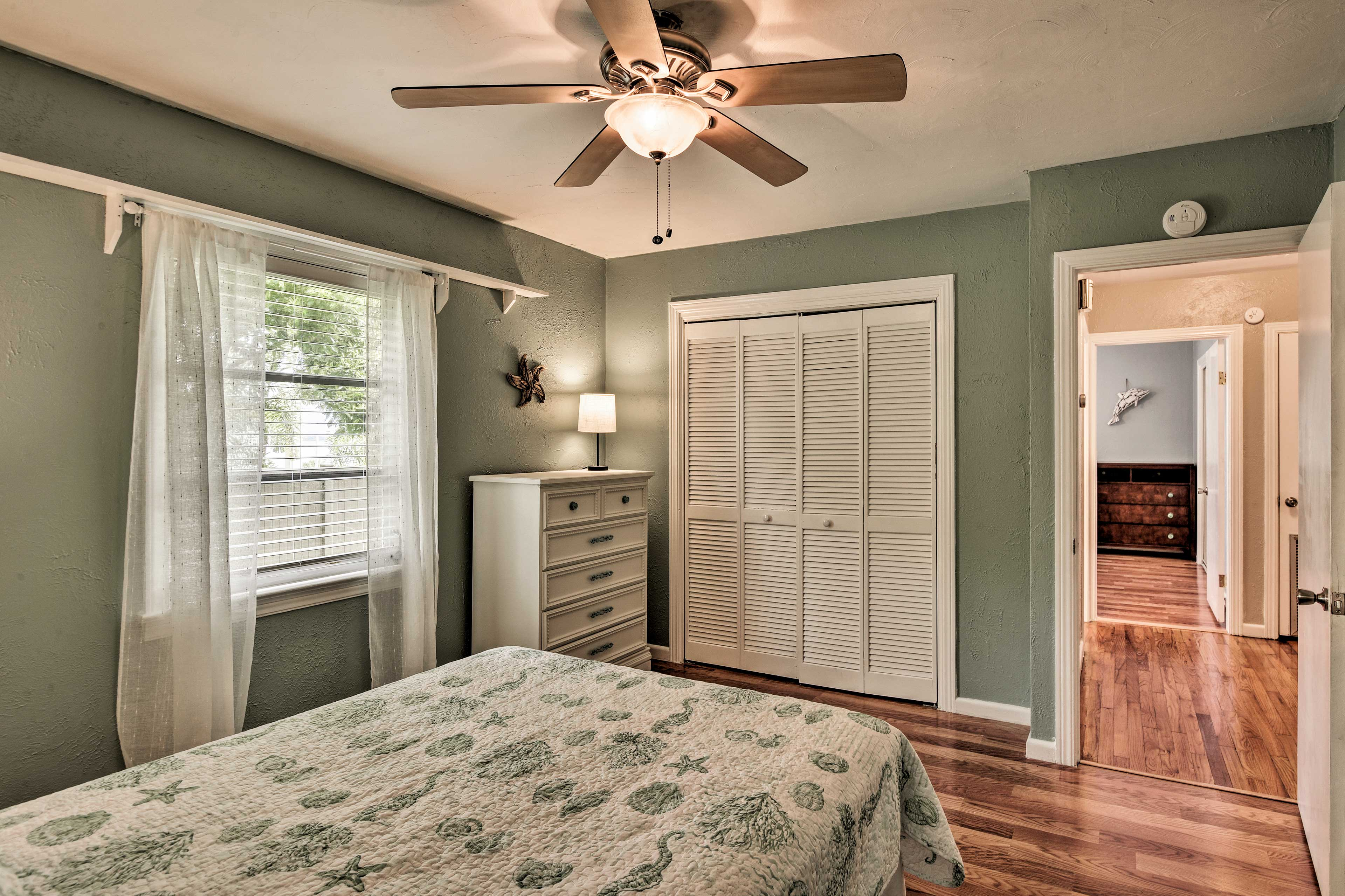 Hardwood floors flow continuously throughout the house.